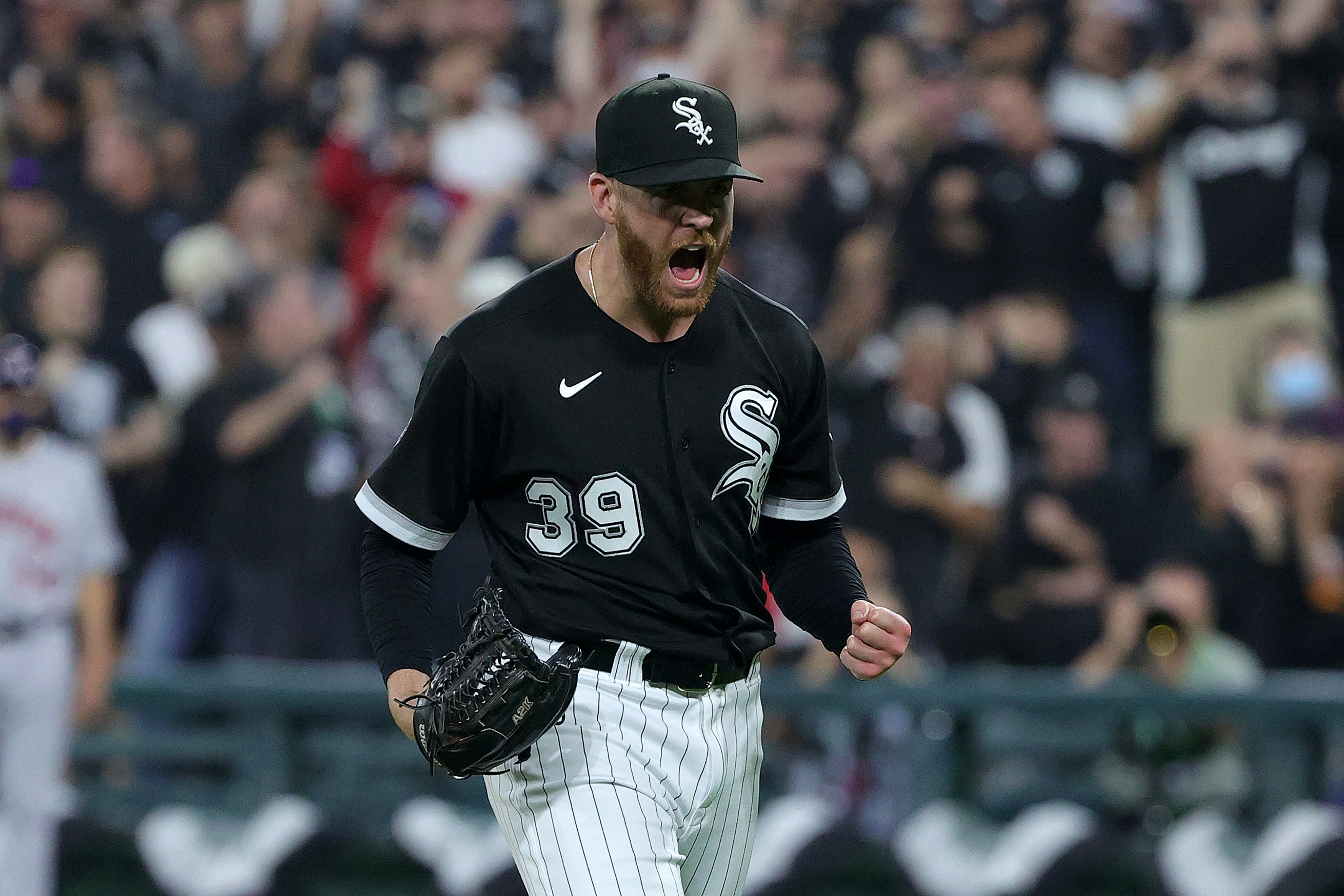 The White Sox' Aaron Bummer reacts after a strikeout in the seventh inning of the 12-6 ALDS Game 3 win over the Astros.