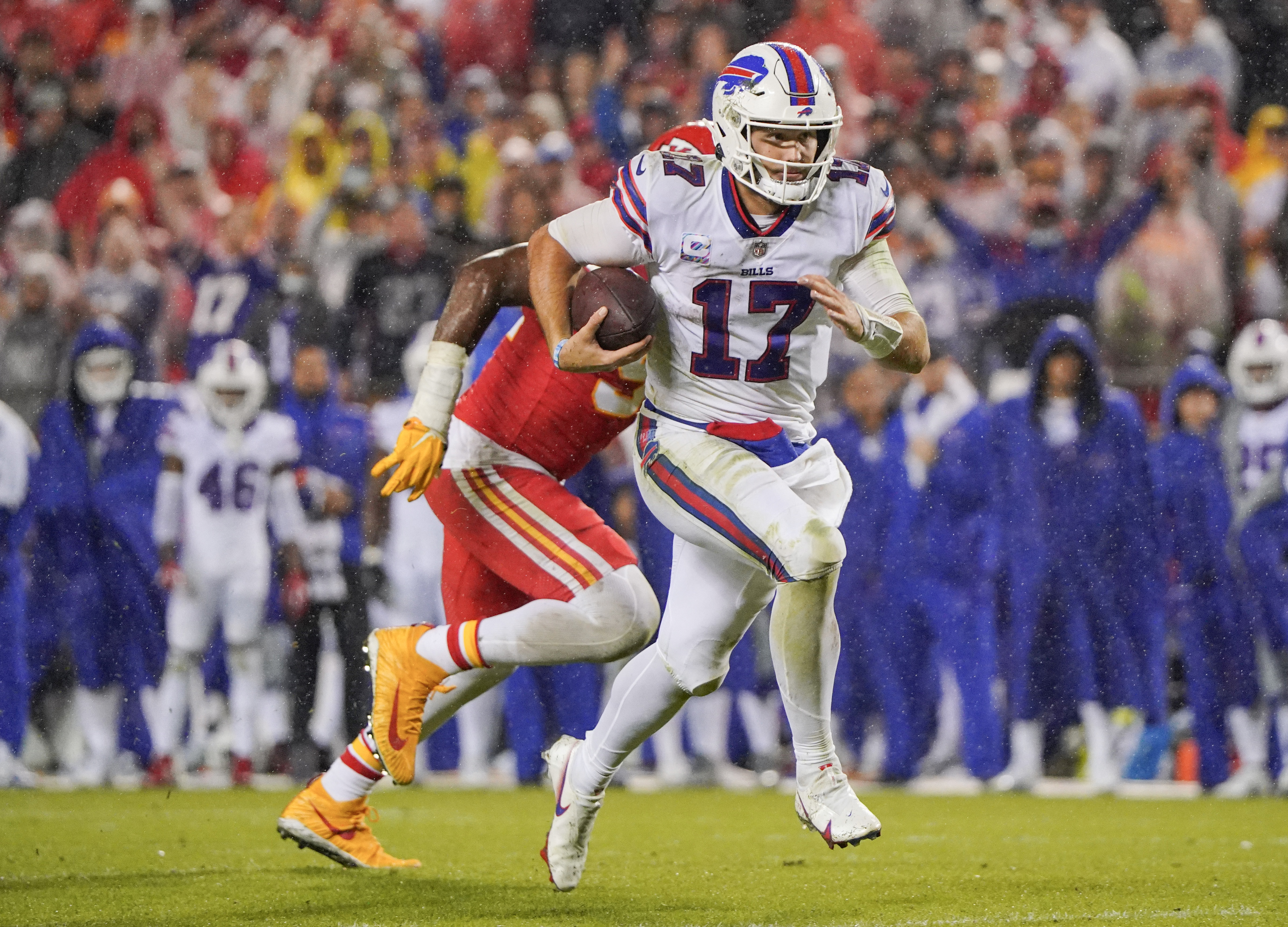 Buffalo Bills quarterback Josh Allen (17) runs the ball against the Kansas City Chiefs during the second half at GEHA Field at Arrowhead Stadium.