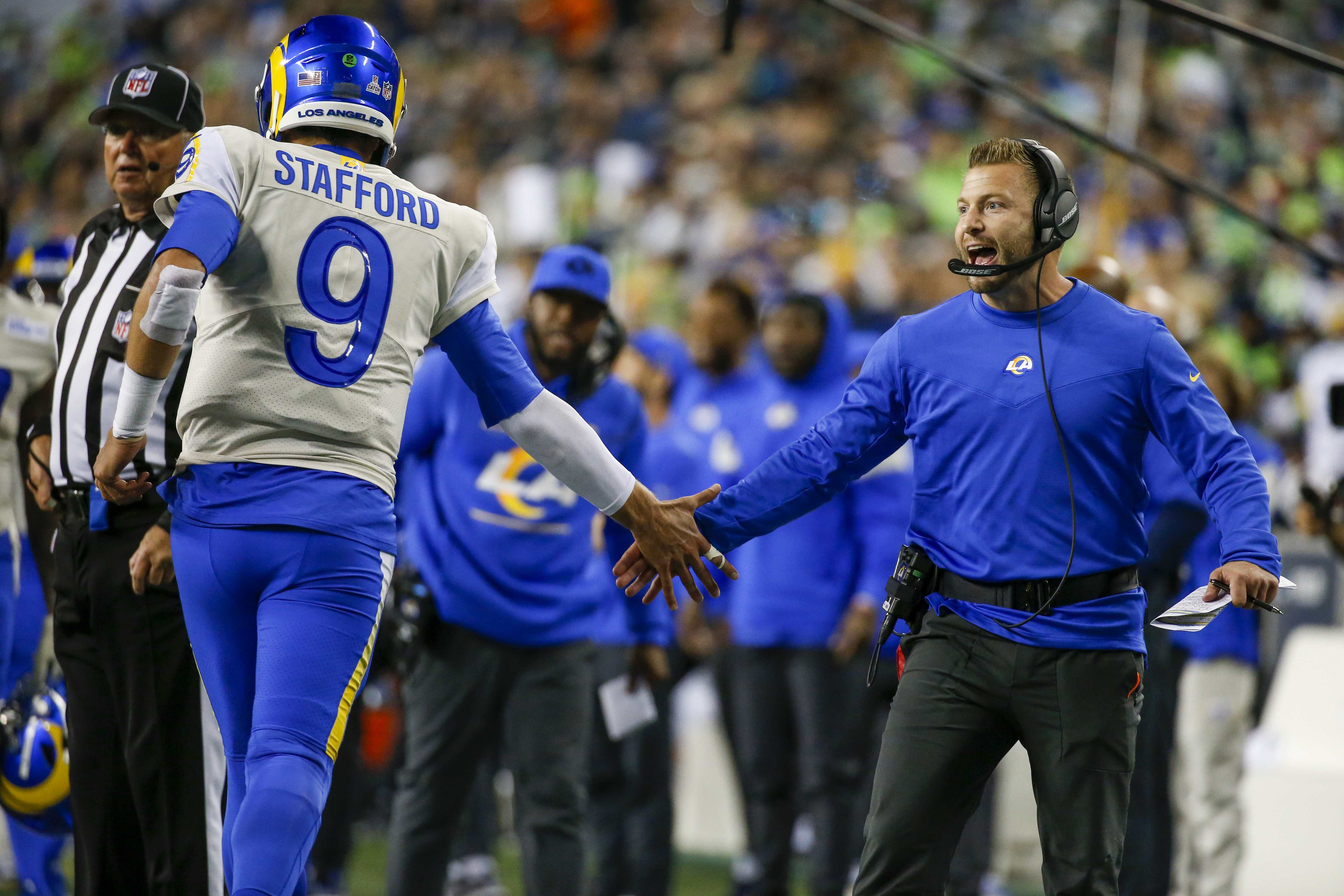Los Angeles Rams head coach Sean McVay (right) celebrates with quarterback Matthew Stafford (9) following a touchdown against the Seattle Seahawks during the fourth quarter at Lumen Field.