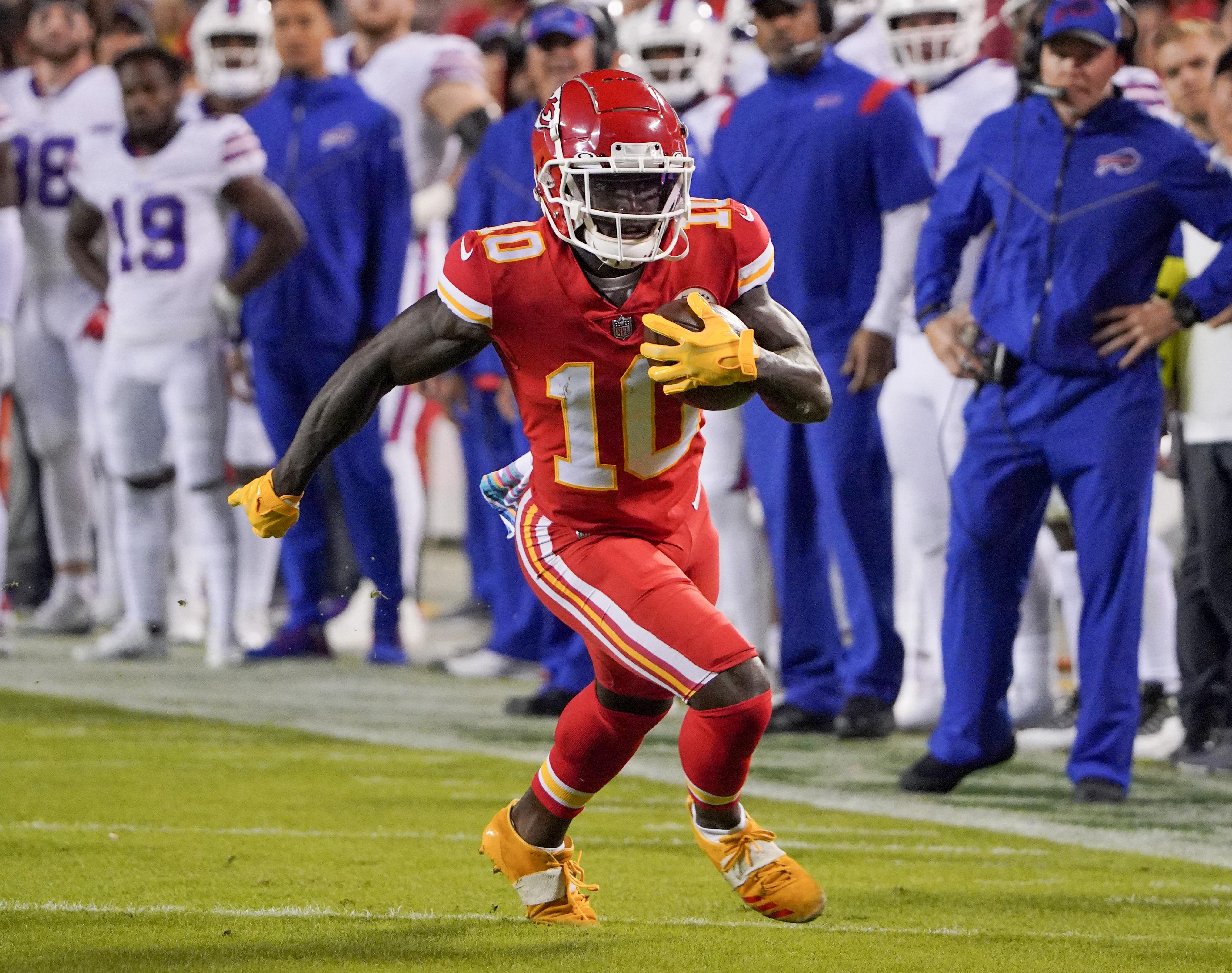 Kansas City Chiefs wide receiver Tyreek Hill (10) runs the ball against the Buffalo Bills during the first half at GEHA Field at Arrowhead Stadium.