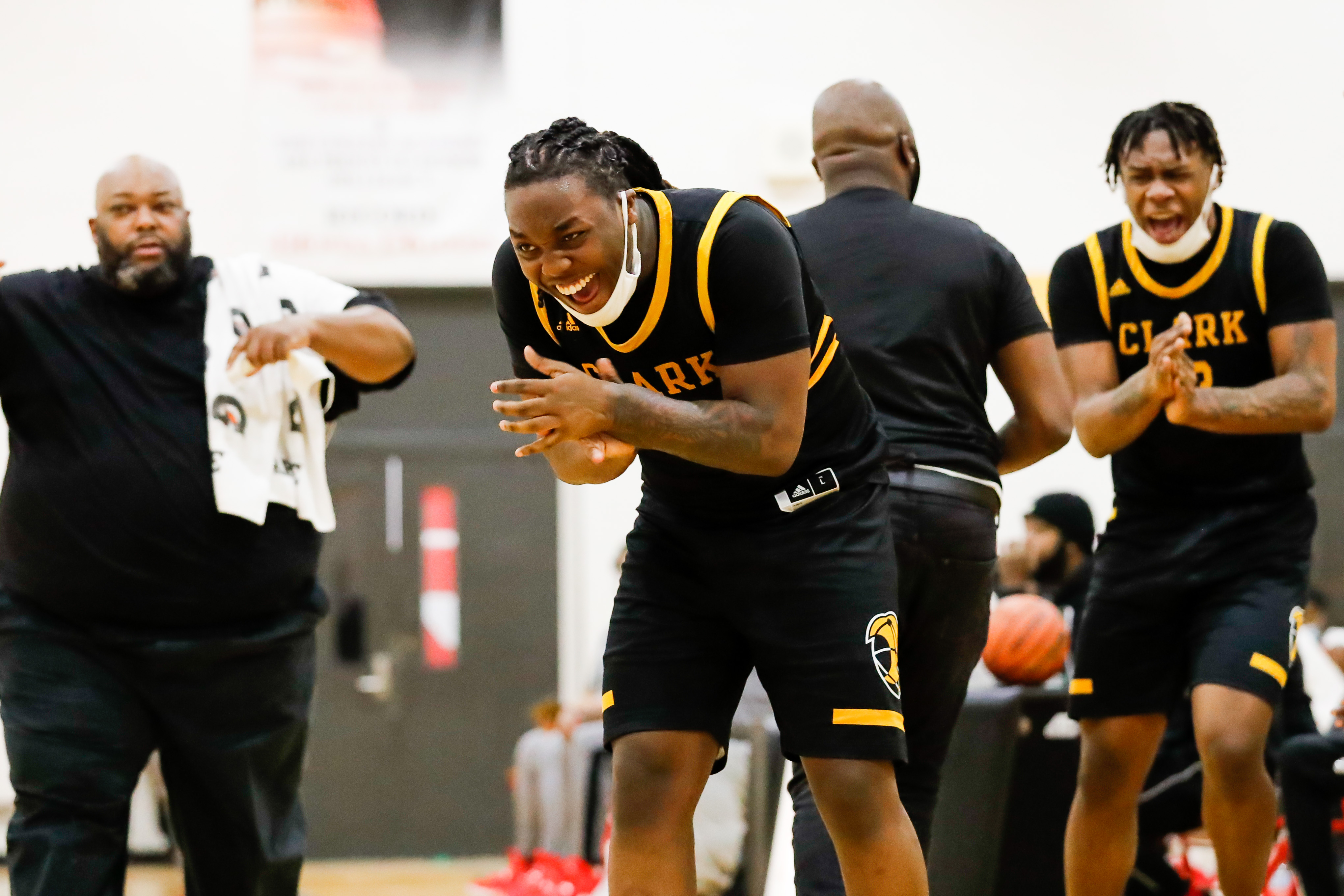 Clark players react during a game against North Lawndale.