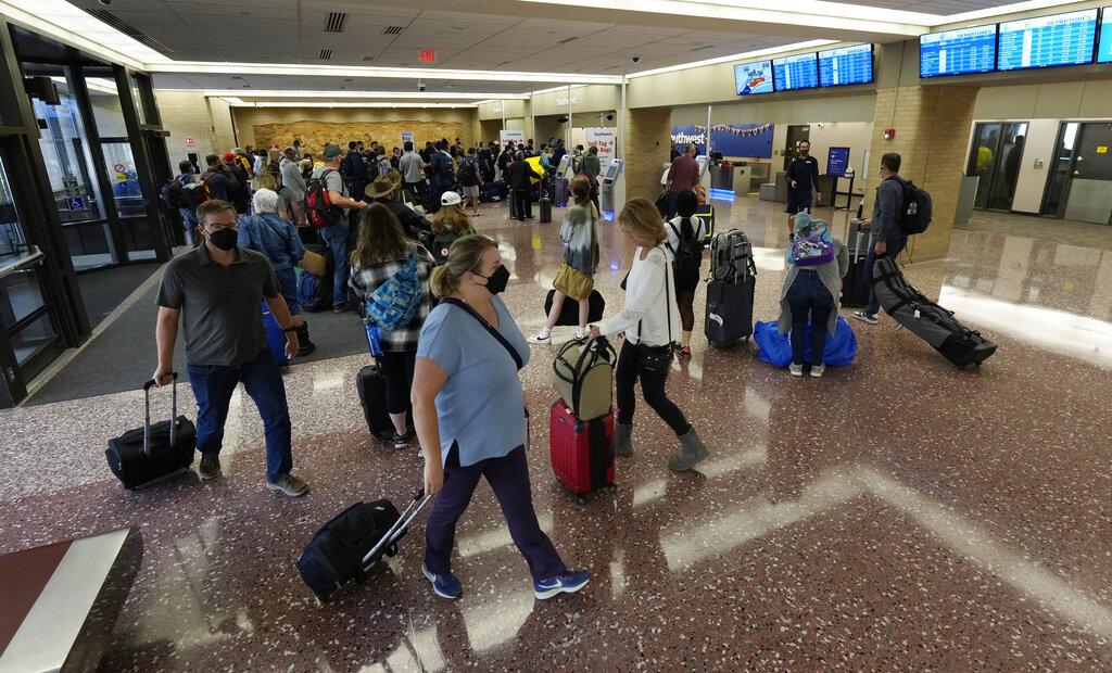 Passengers for Southwest Airlines after Southwest Airlines canceled hundreds of flights.