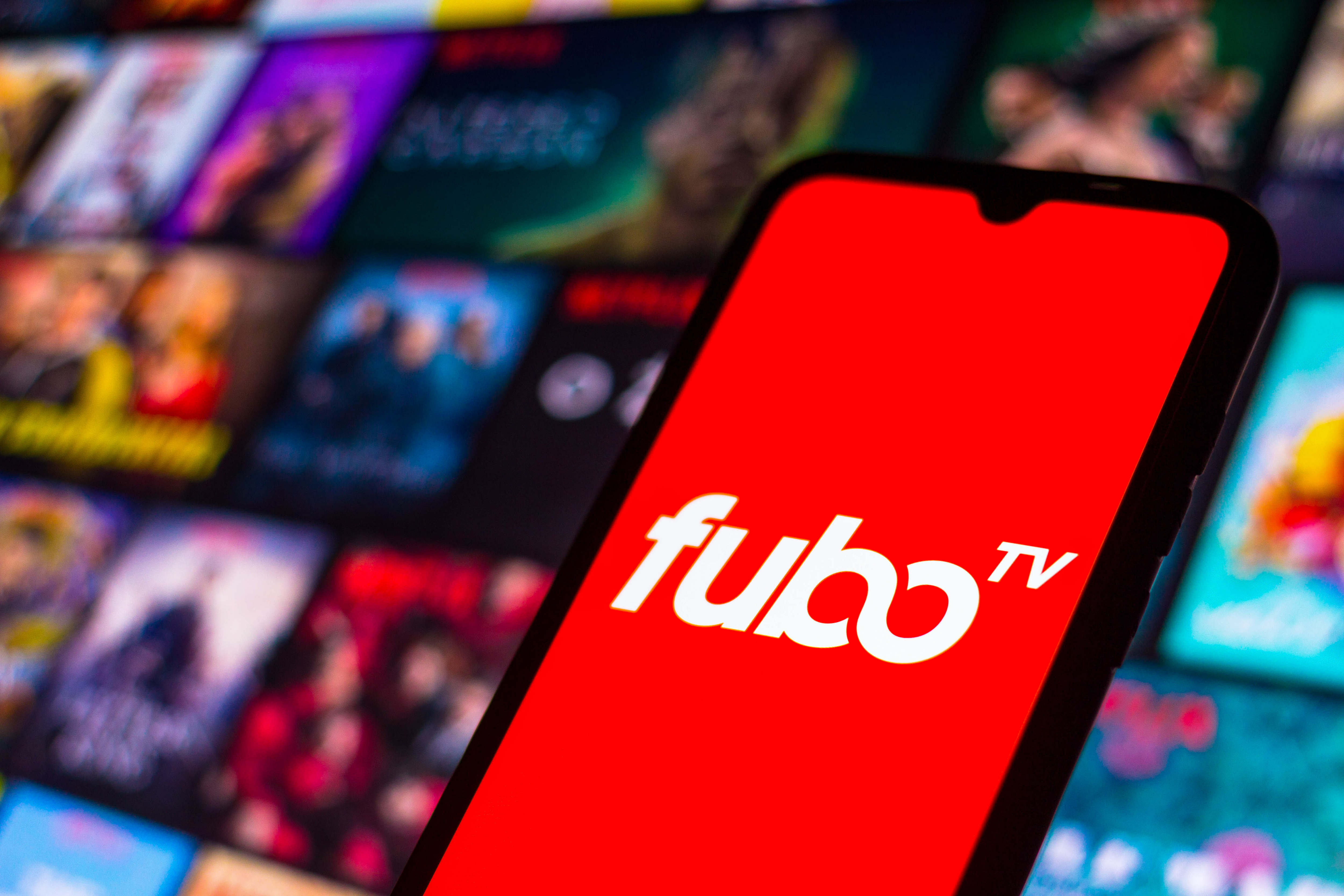 In this photo illustration the FuboTV logo seen displayed on...