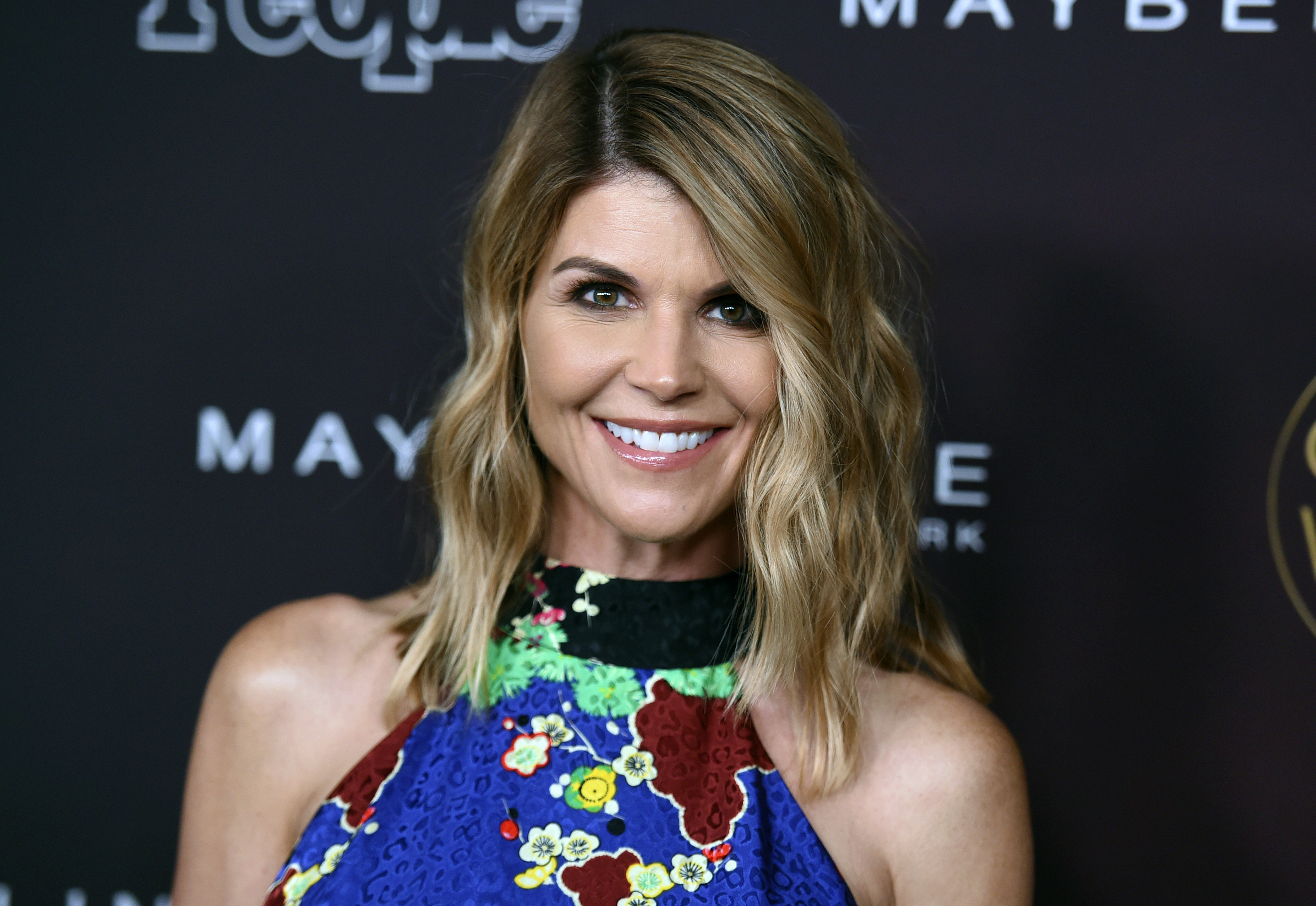 """Actress Lori Loughlin arrives at the annual People Magazine """"Ones To Watch"""" party in Los Angeles."""