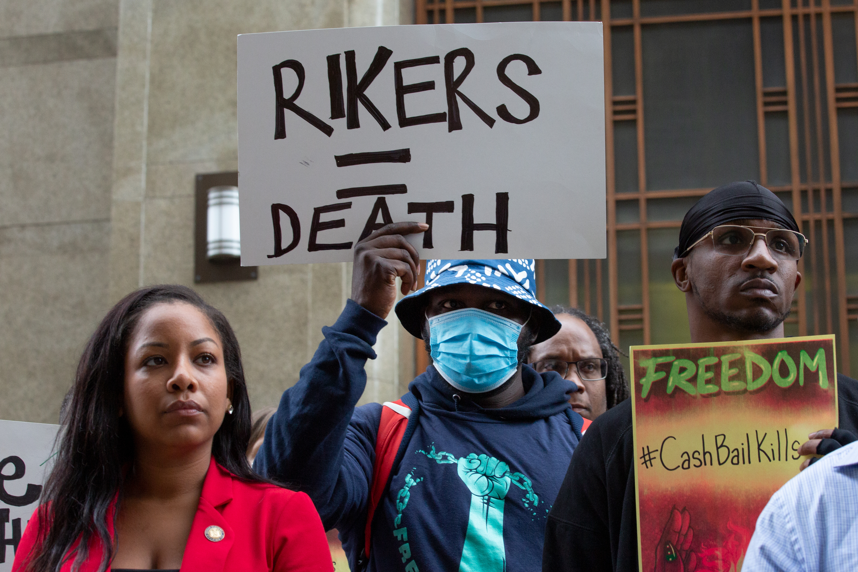 Criminal justice reform protesters advocated outside the Manhattan District Attorney's office for the end of cash bail after a dozen people died in city jails this year, Oct. 6, 2021.