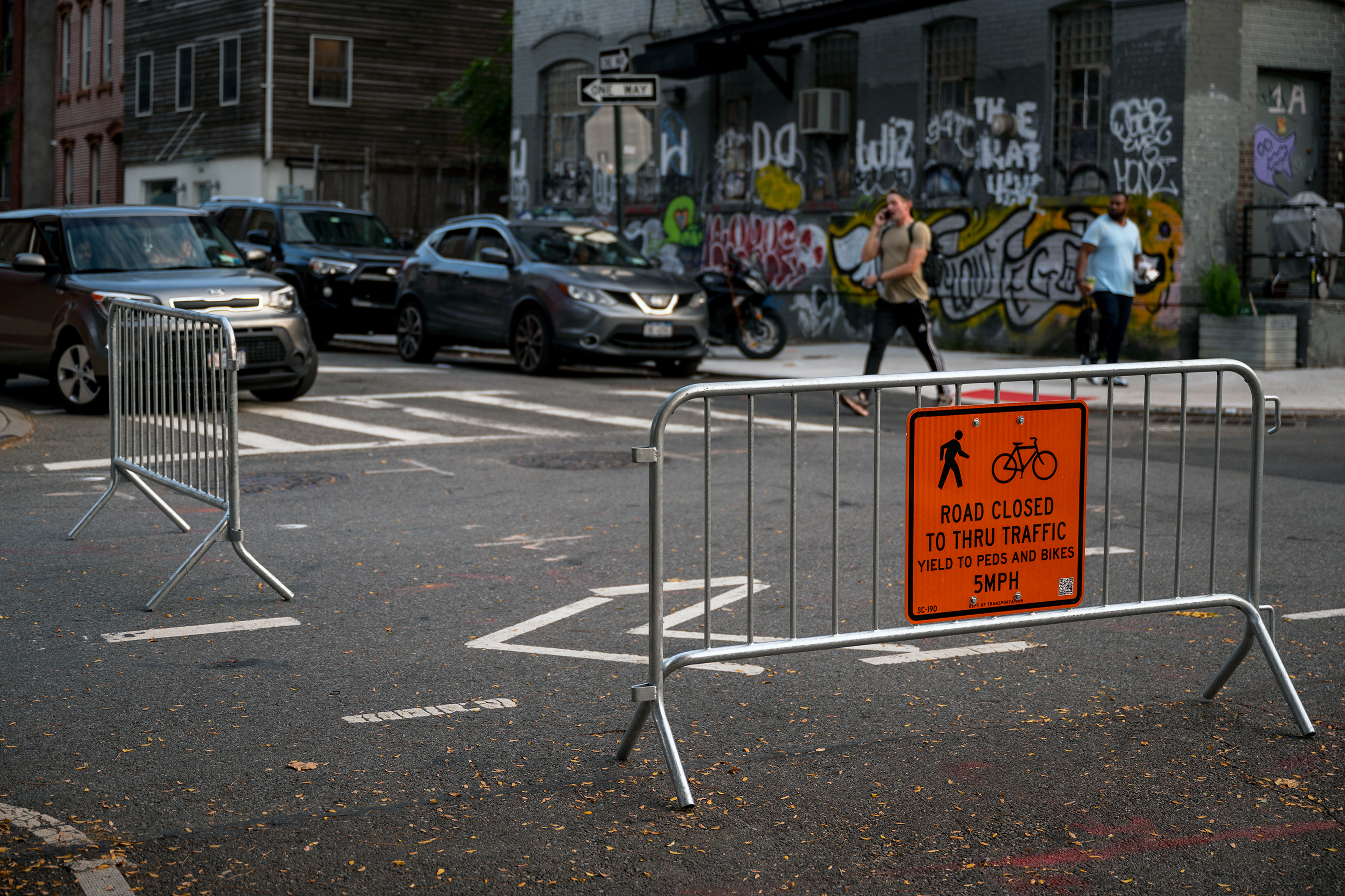 Pedestrians and cyclists take advantage of a closed-off section of Berry Street in Williamsburg as part of the city's Open Streets program, Oct. 8, 2021.