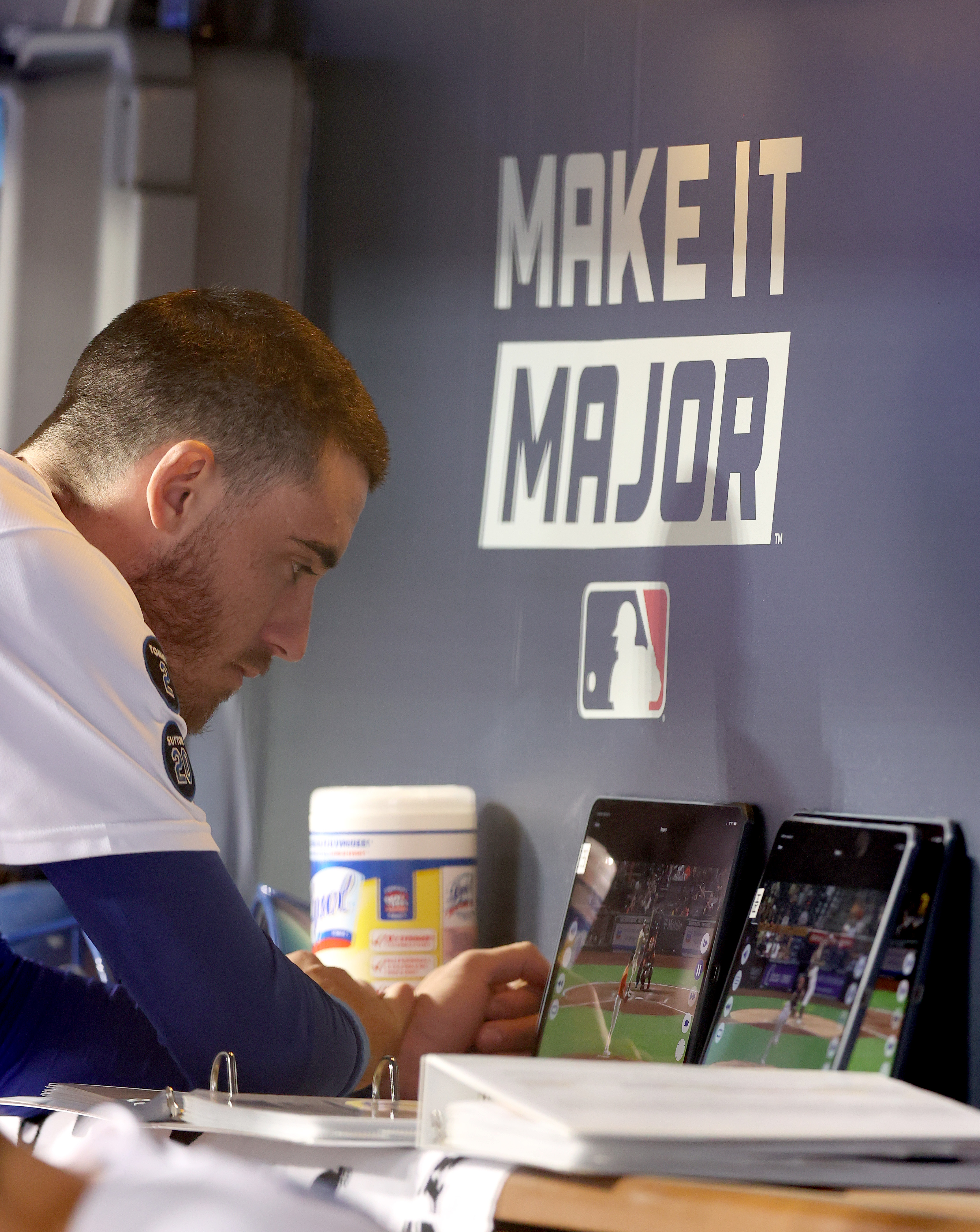 Cody Bellinger #35 of the Los Angeles Dodgers watches a replay against the San Francisco Giants during the fifth inning in game 3 of the National League Division Series at Dodger Stadium