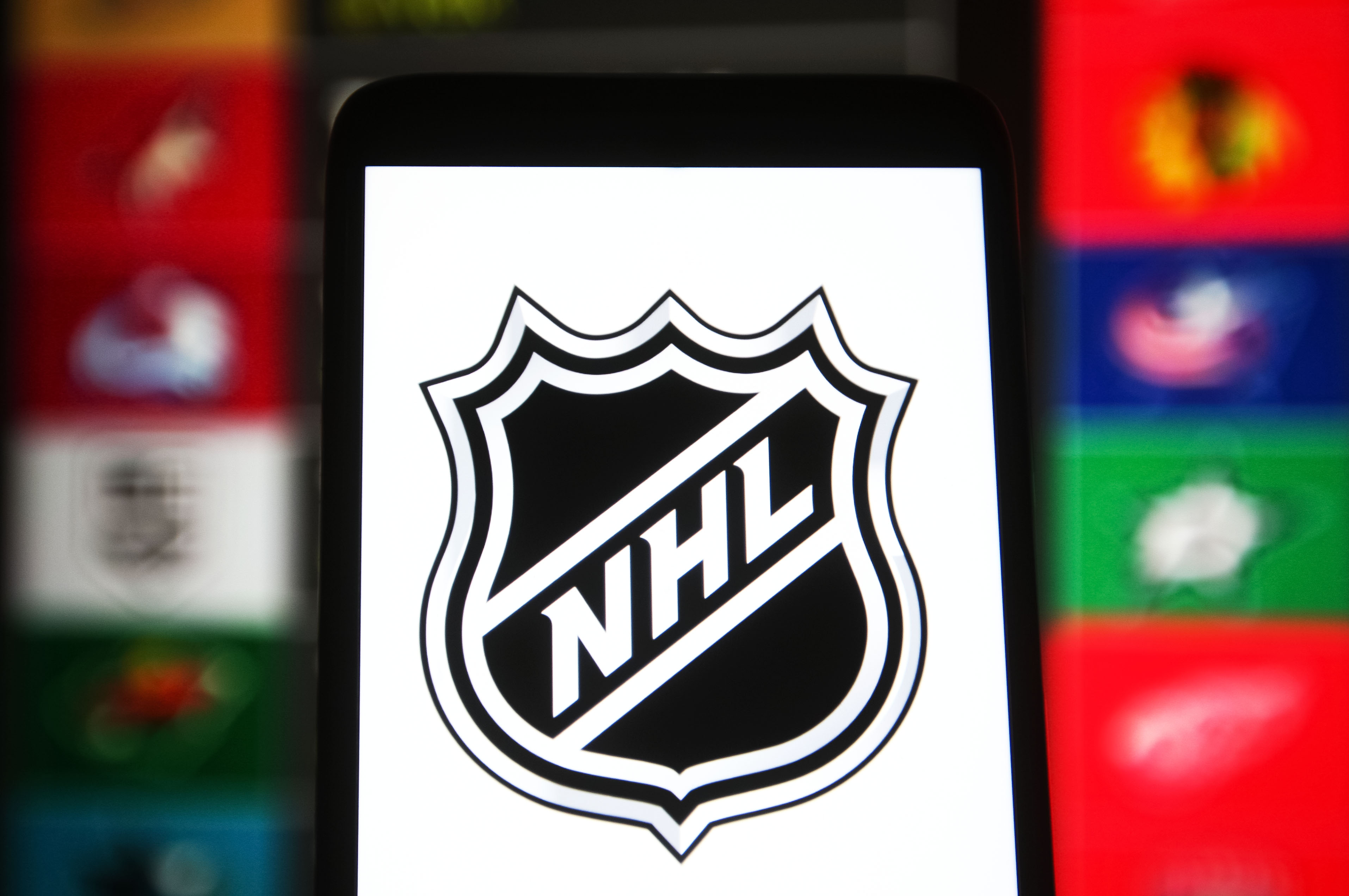 In this photo illustration, National Hockey League (NHL)...