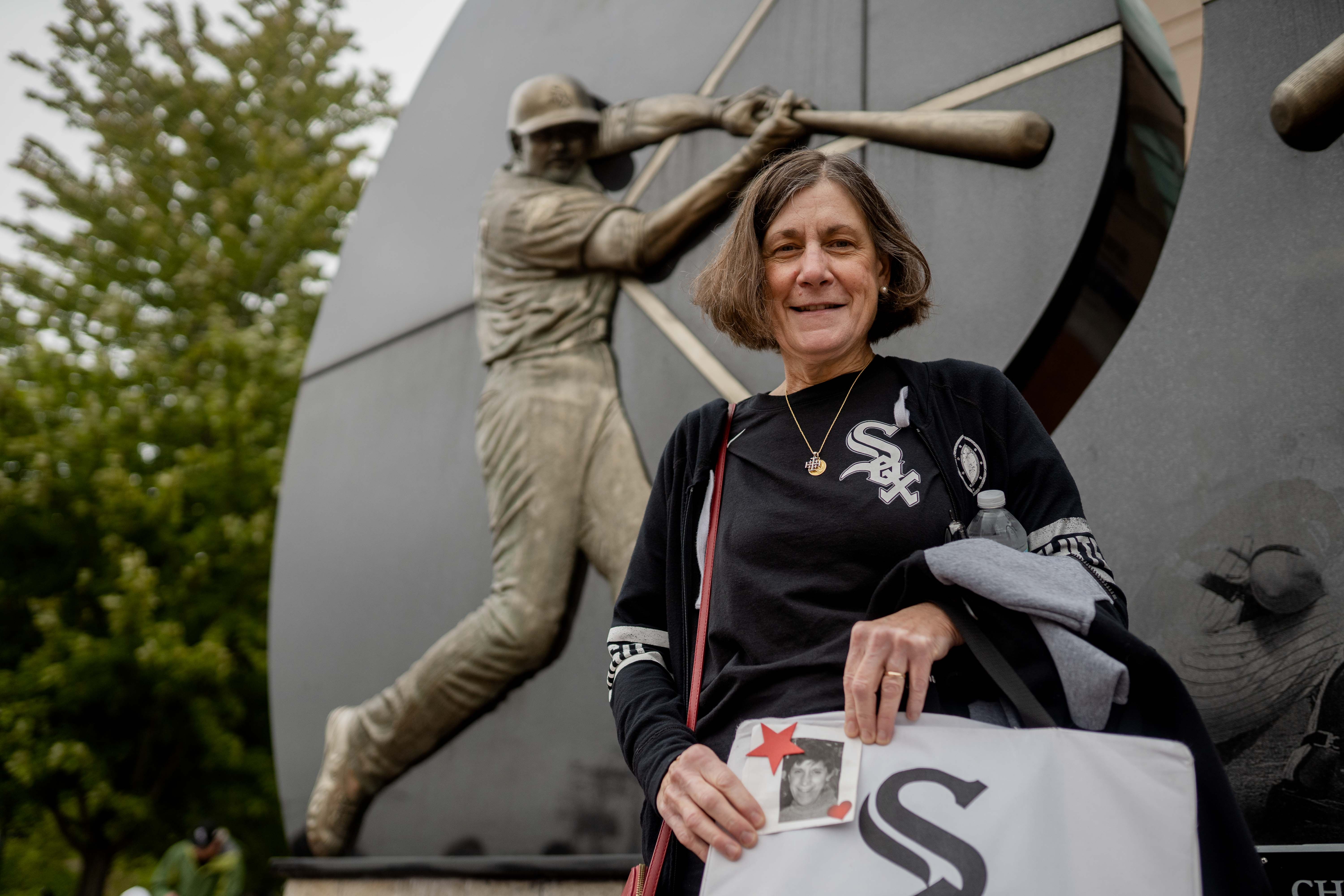 White Sox fan Sharon Bresnahan, who lost her twin sister Sheryl, poses for a photo outside the Guaranteed Rate Field on Oct. 23, 2021.