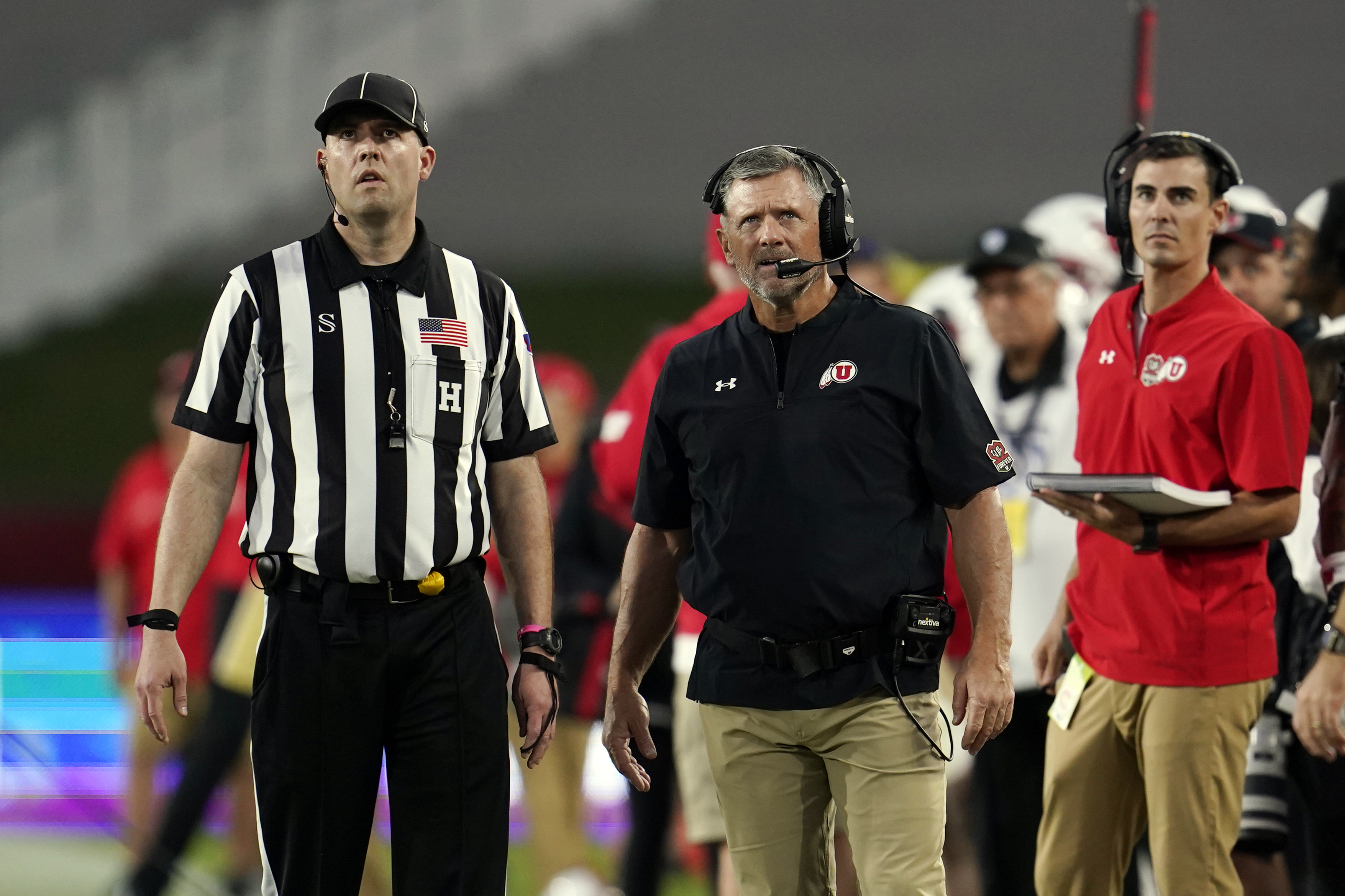 Utah head coach Kyle Whittingham stands next to a referee during game against Southern California Saturday, Oct. 9, 2021, in Los Angeles.