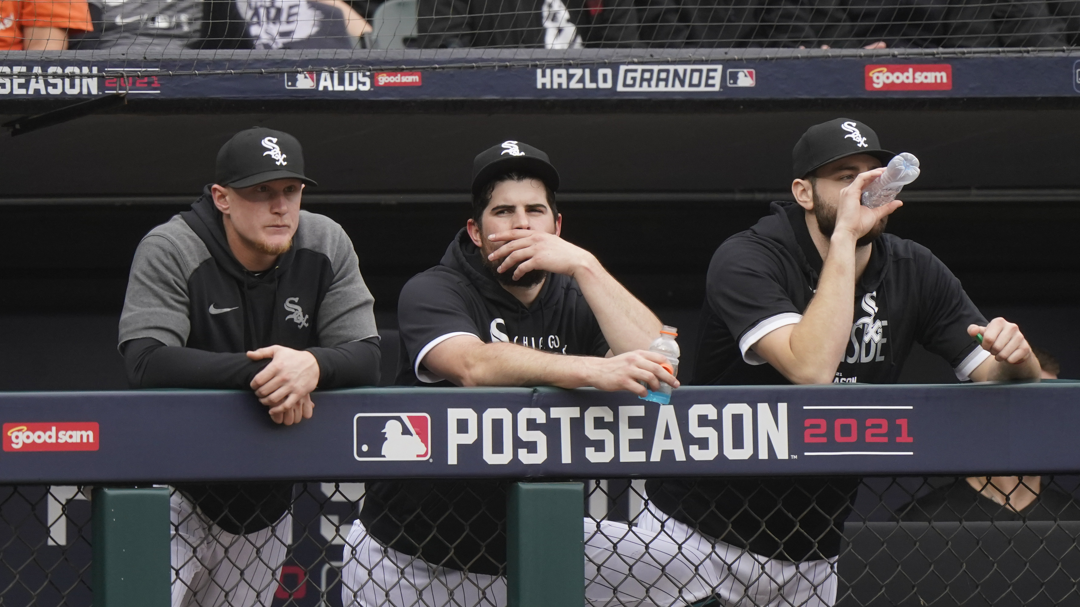 White Sox pitcher Carlos Rodon, center, watches from the dugout with Andrew Vaughn, left, and Lucas Giolito during the 10-1 Game 4 of the ALDS at Guaranteed Rate Field.