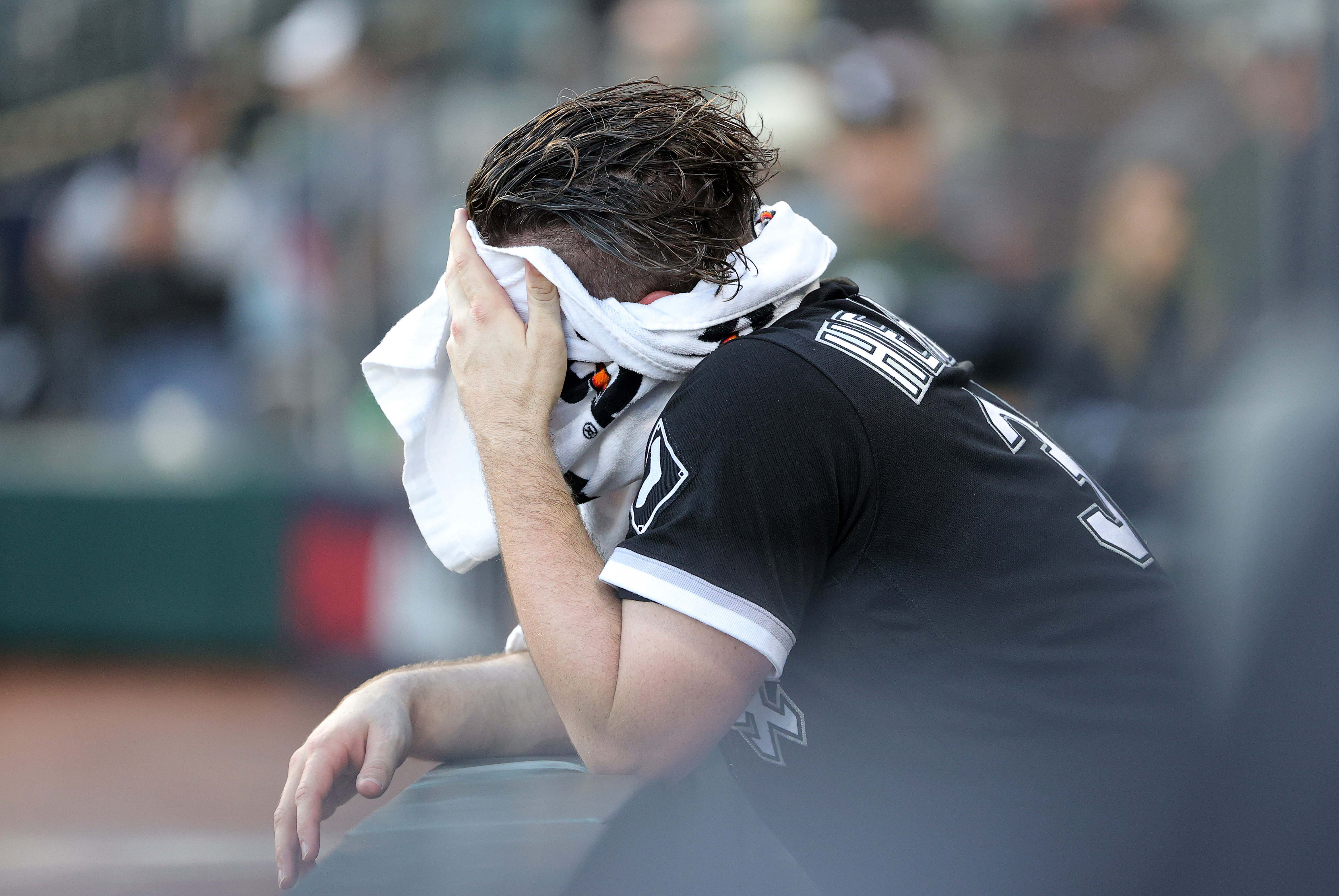 White Sox closer Liam Hendriks hides his face in a towel after the Houston Astros' 10-1 win in Game 4 of the American League Division Series at Guaranteed Rate Field.