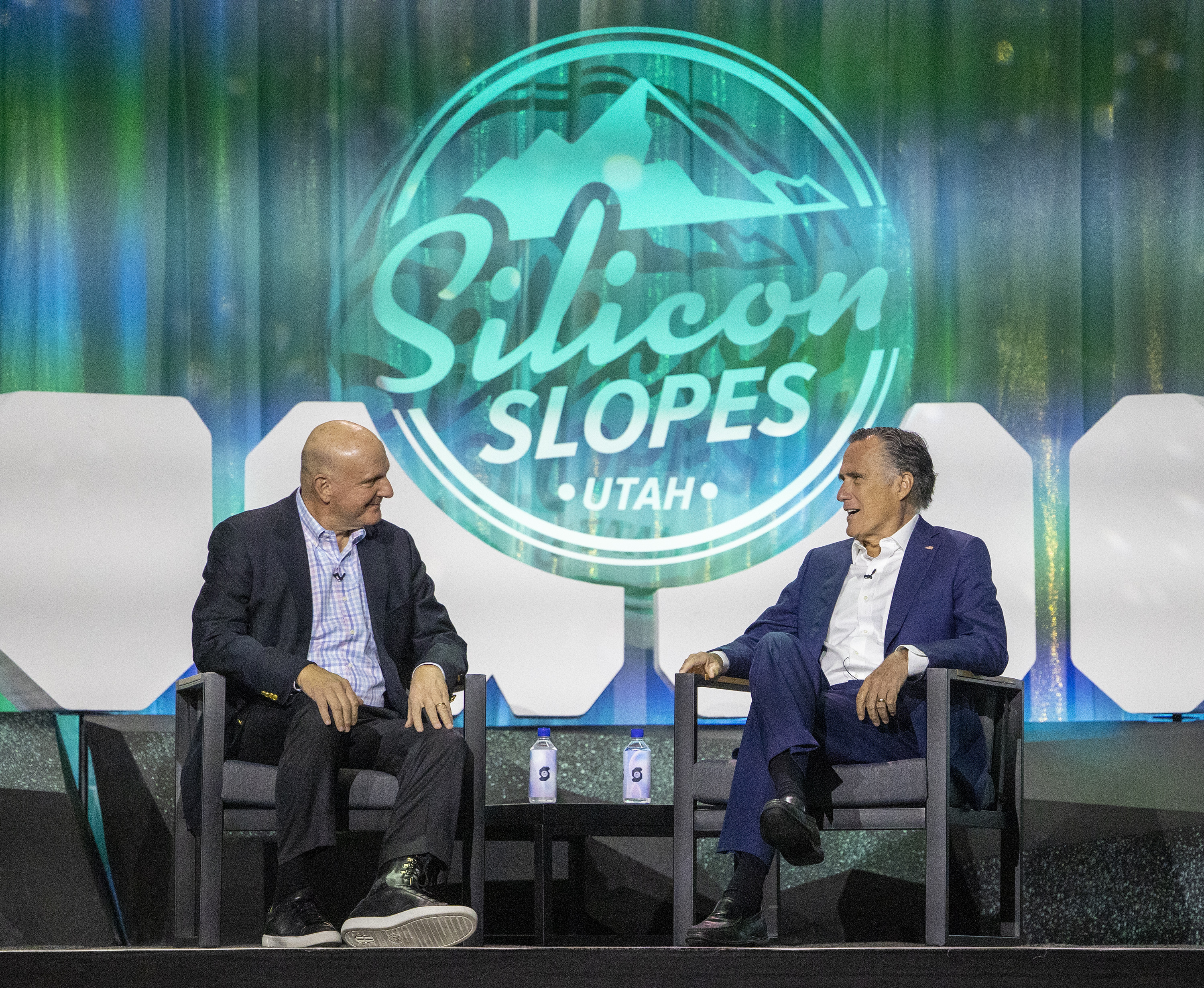 Steve Ballmer, LA Clippers owner and former Microsoft CEO, talks with Utah Sen. Mitt Romney at the Silicon Slopes Summit.