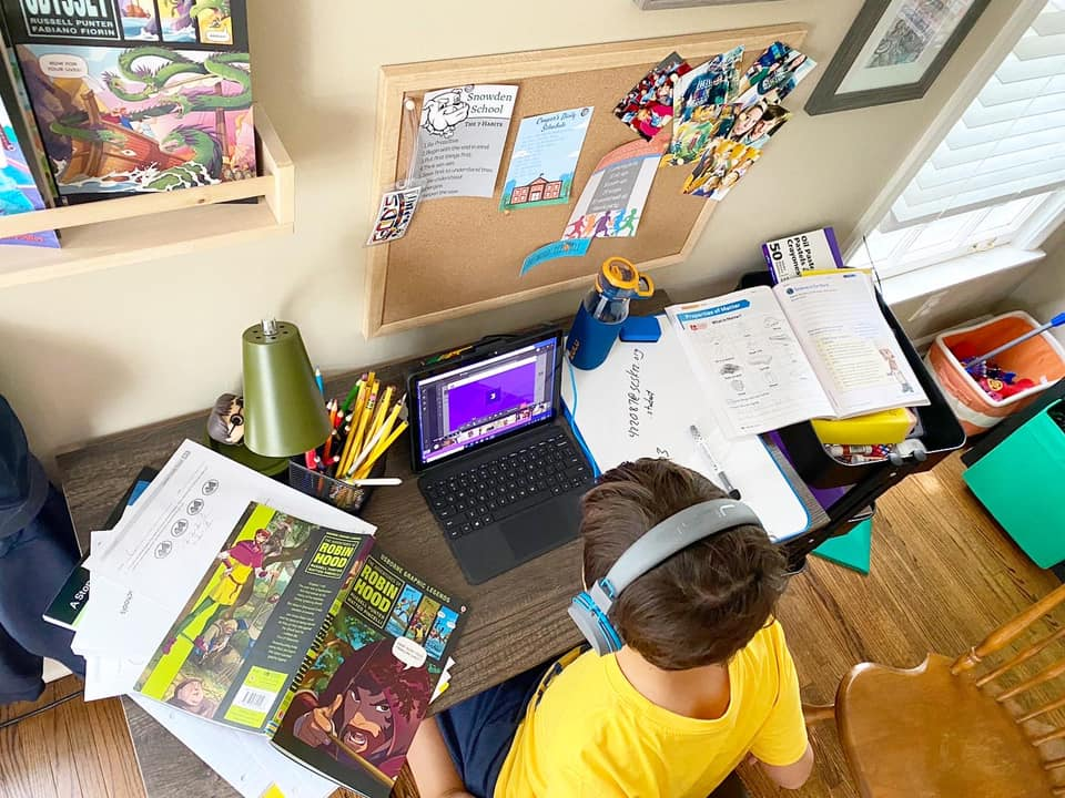 Aiden Tate completes schoolwork virtually last spring at his Memphis home.
