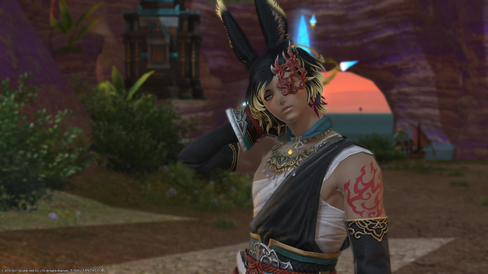 A male Viera in monk artifact gear stands in from of an Aetheryte