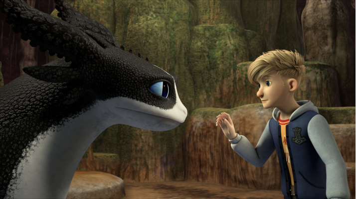 a blonde boy in a hoodie tentatively approaches a black and white dragon