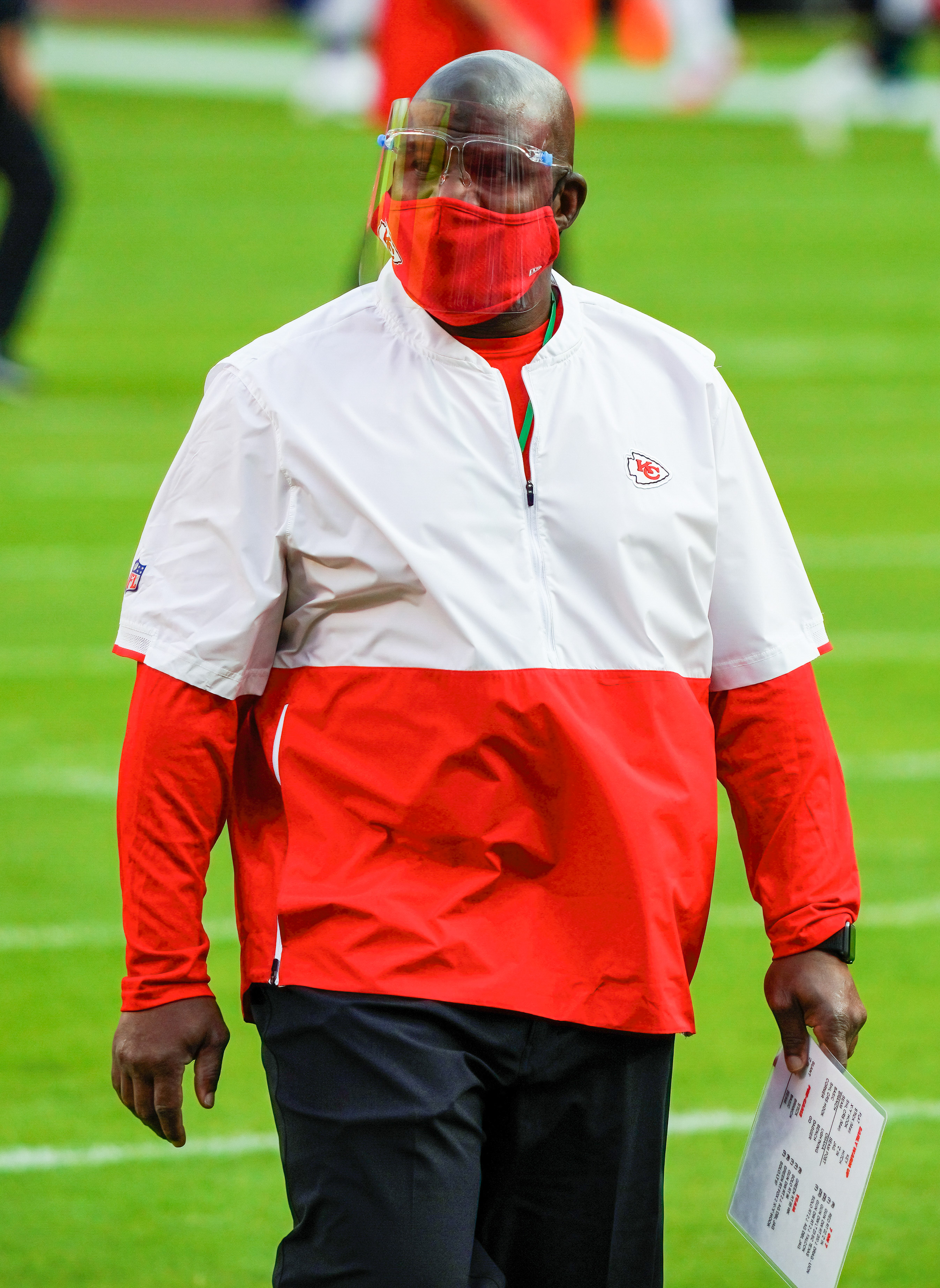 Kansas City, Missouri, USA; Kansas City Chiefs offensive coordinator Eric Bienemy looks on during warmups before the game against the New England Patriots at Arrowhead Stadium.