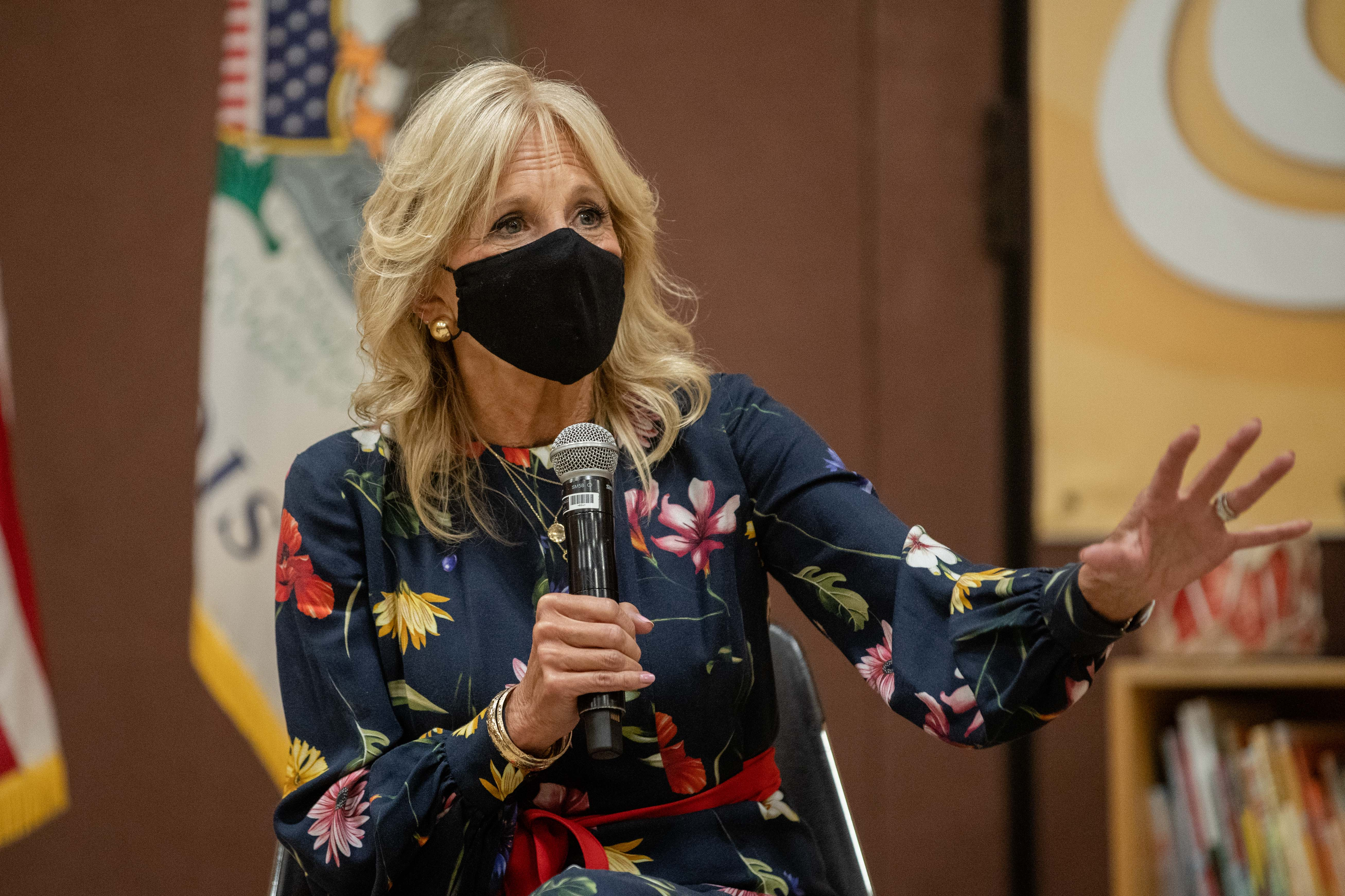 First lady Jill Biden speaks with community leaders and Education Secretary Miguel Cardona at Arturo Velasquez Institute on Wednesday, Oct. 13, 2021.