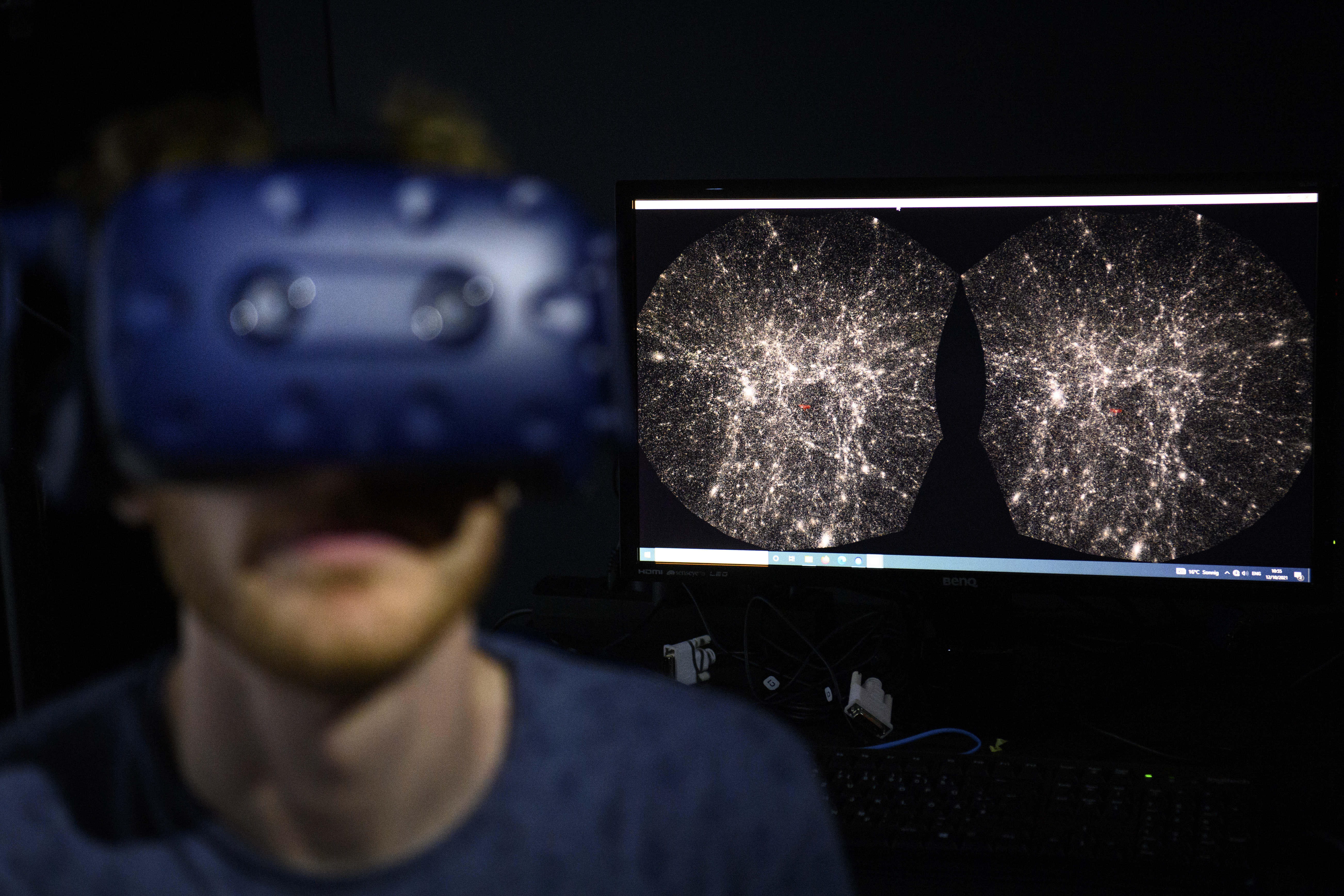 Software engineer Hadrien Gurnel uses a virtual reality helmet to explore the most detailed 3D map of the universe with the virtual reality software VIRUP — Virtual Reality Universe Project. It was developed by Swiss Federal Institute of Technology (EPFL) scientists of the Laboratory of Astrophysics at EPFL's Laboratory for Experimental Museology (eM+) in St-Sulpice near Lausanne, Switzerland.
