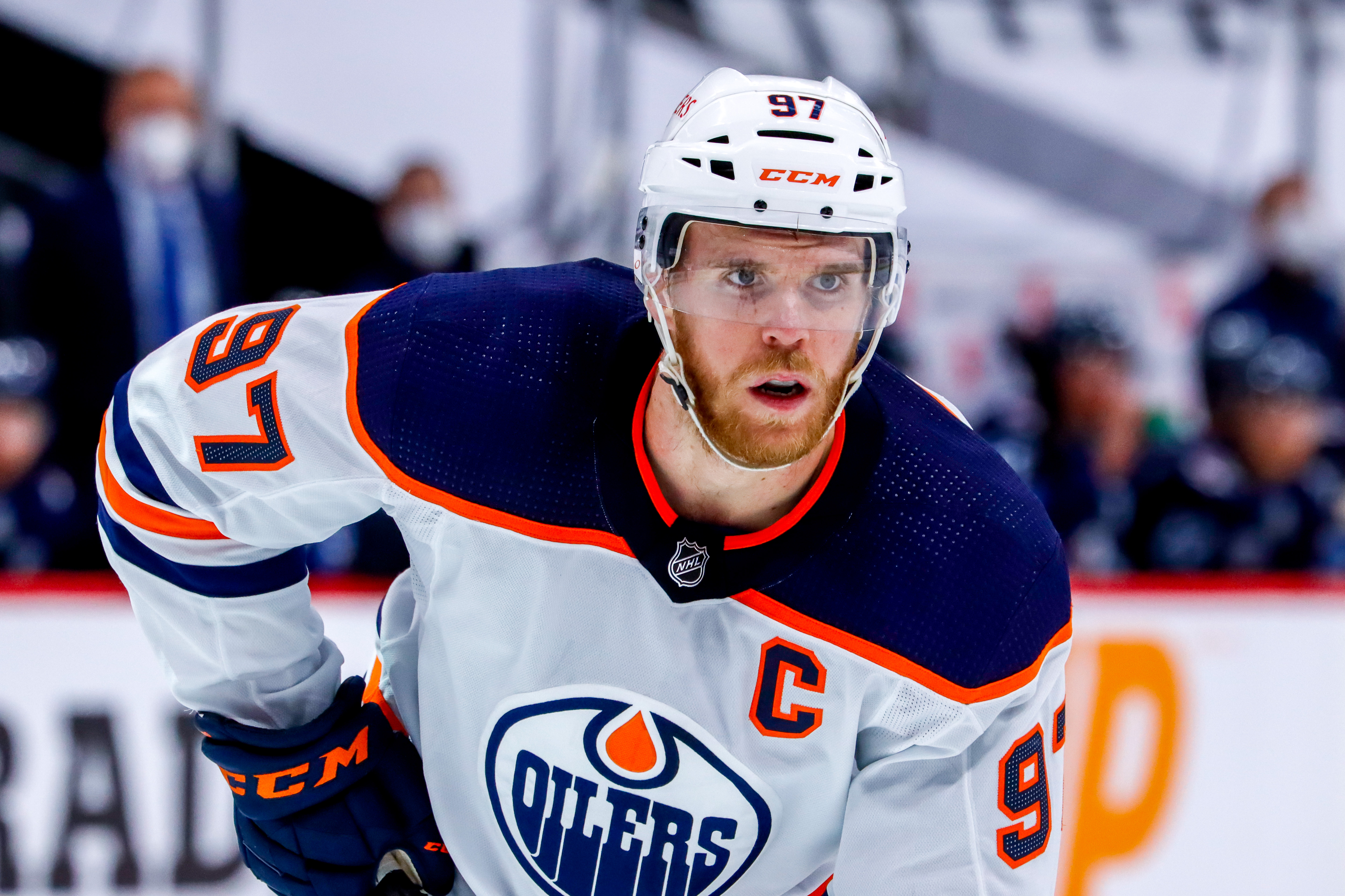 Connor McDavid #97 of the Edmonton Oilers prepares for a second period face-off against the Winnipeg Jets in Game Four of the First Round of the 2021 Stanley Cup Playoffs at Bell MTS Place on May 24, 2021 in Winnipeg, Manitoba.