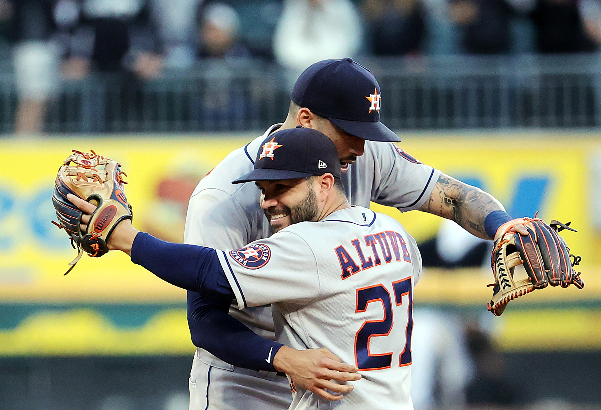 Jose Altuve (27) and Carlos Correa celebrate after the Astros beat the White Sox 10-1 Tuesday to win their American League Division Series.