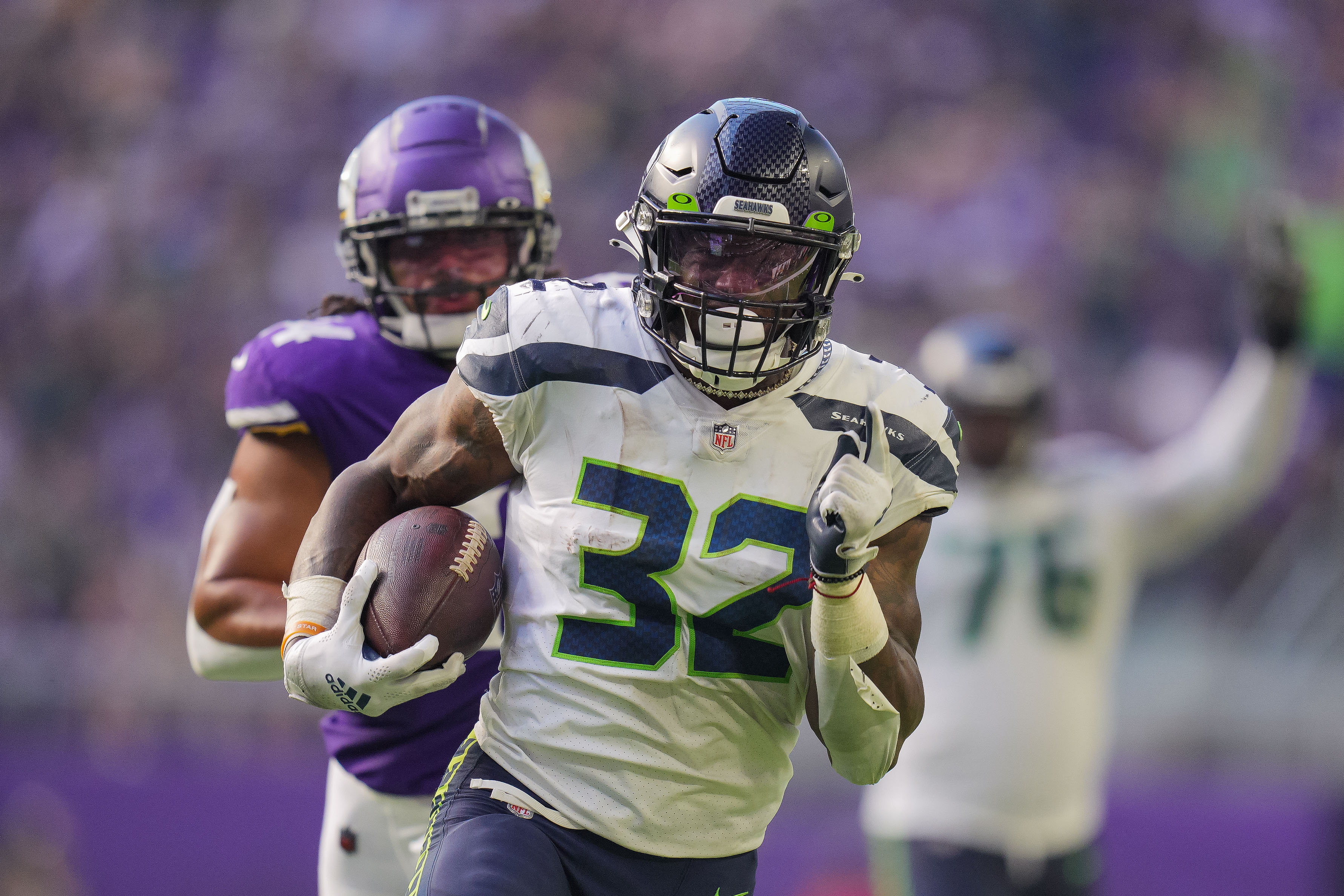 Seattle Seahawks running back Chris Carson (32) scores a touchdown against the Minnesota Vikings in the second quarter at U.S. Bank Stadium.