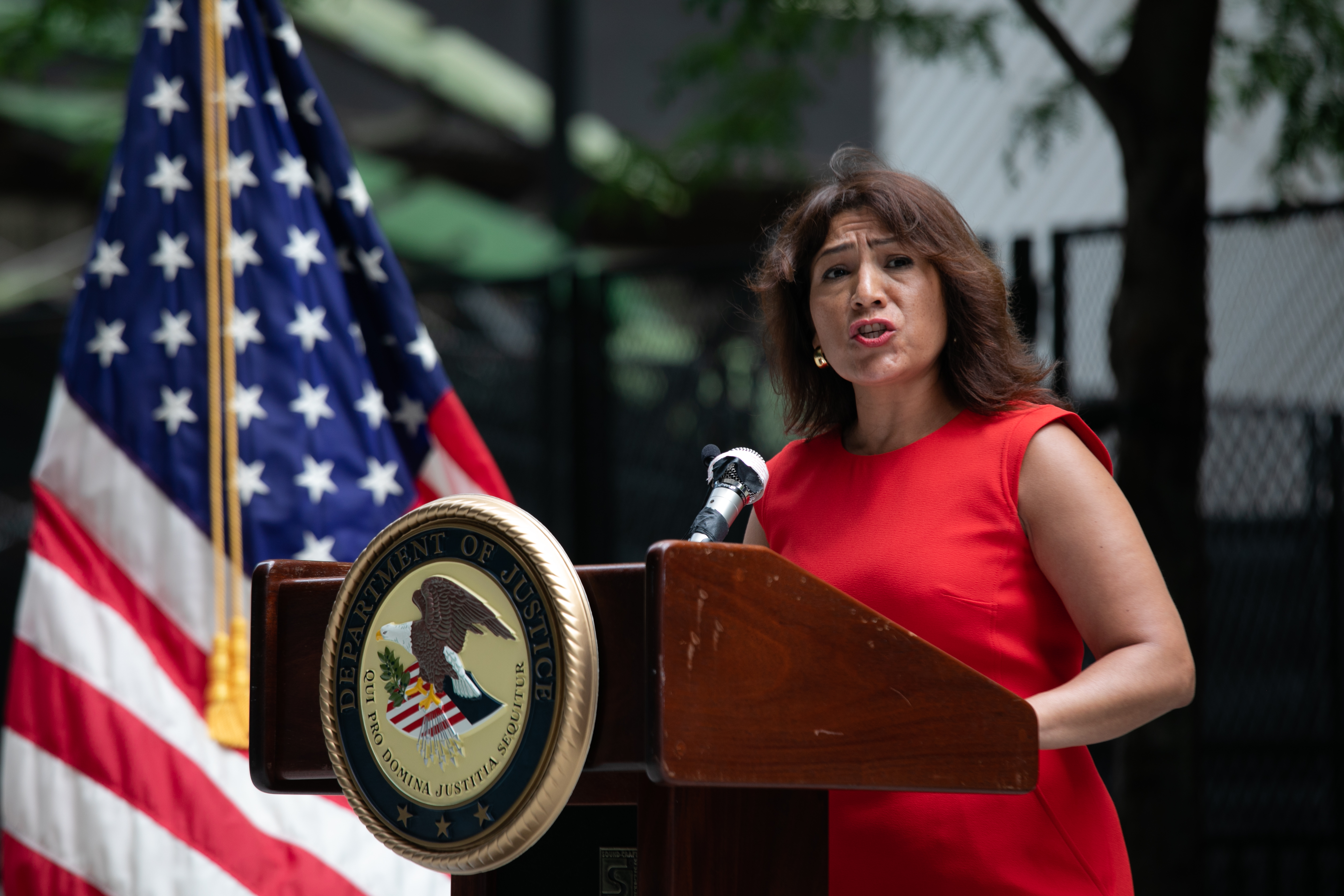 Rosa Escareno, commissioner of Chicago's Department of Business Affairs and Consumer Protection, speaks outside the Dirksen Federal Building on June 30, 2020.
