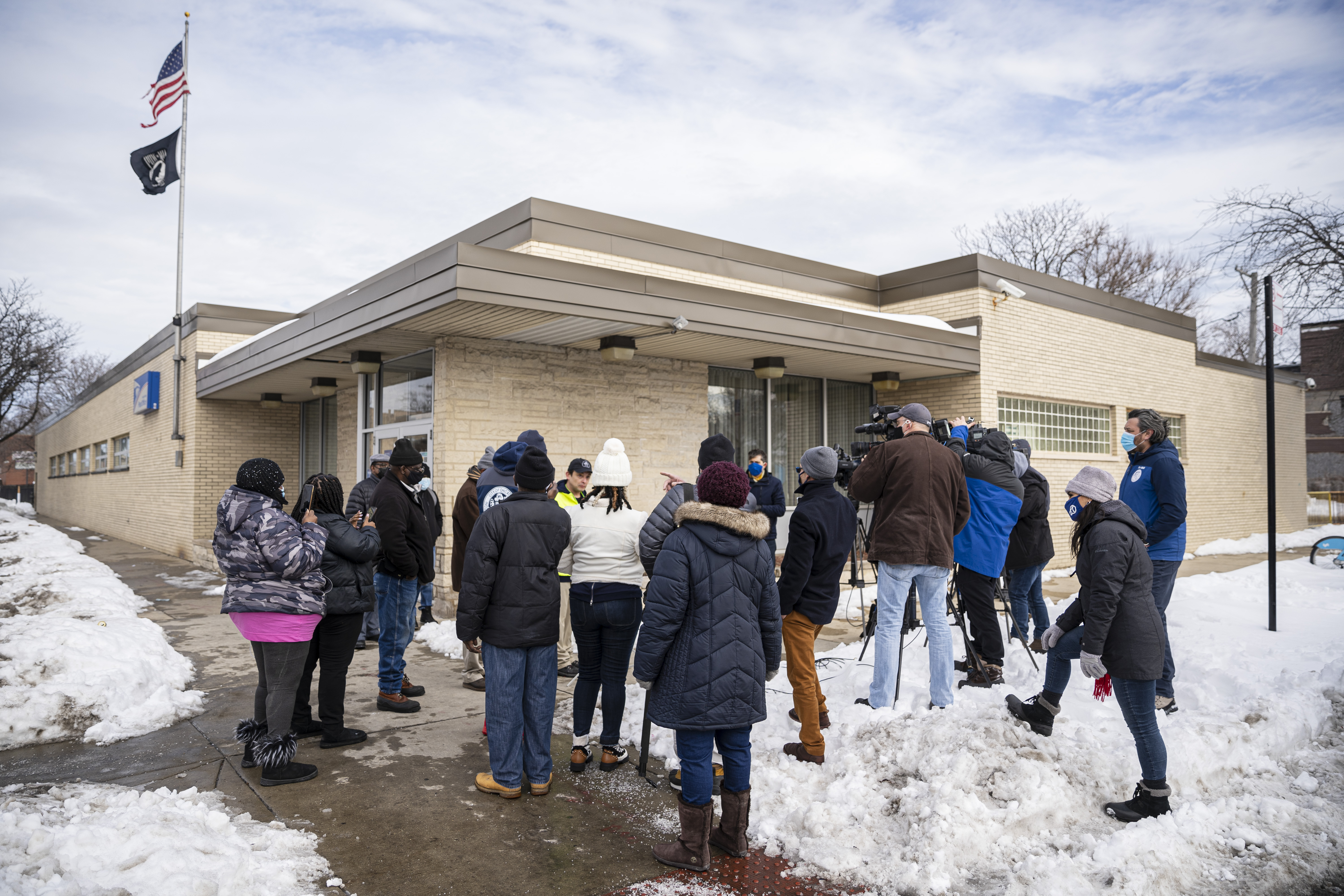 Reporters and local residents gather outside the post office during a press conference to raise awareness of the mail arriving late to residents in Englewood outside of the US Post Office at 6559 S. Ashland in Englewood, Thursday, Feb. 4, 2021. | Anthony Vazquez/Sun-Times