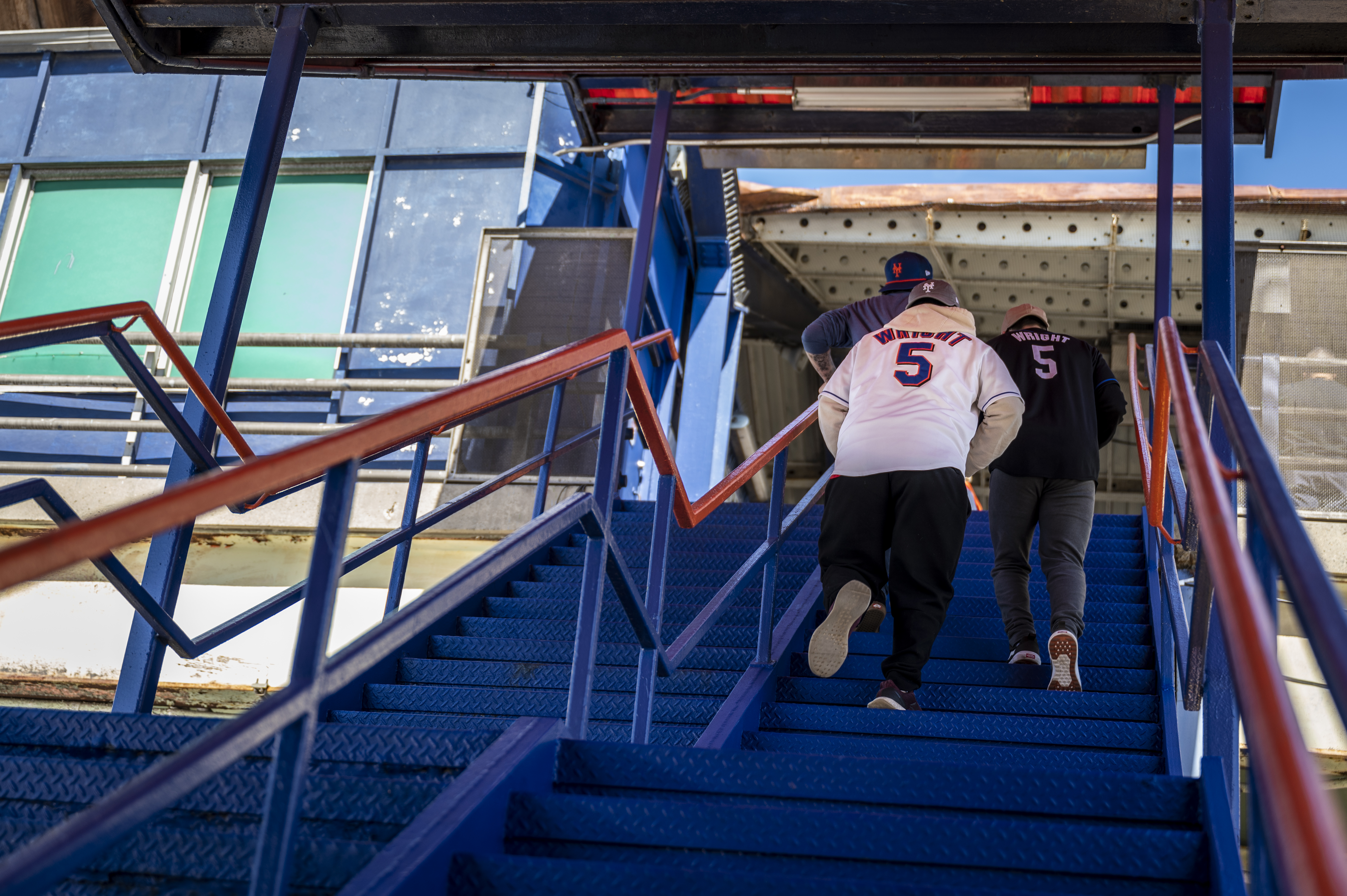 Baseball fans exit LIRR's Mets-Willets Point Station, April 13, 2021.