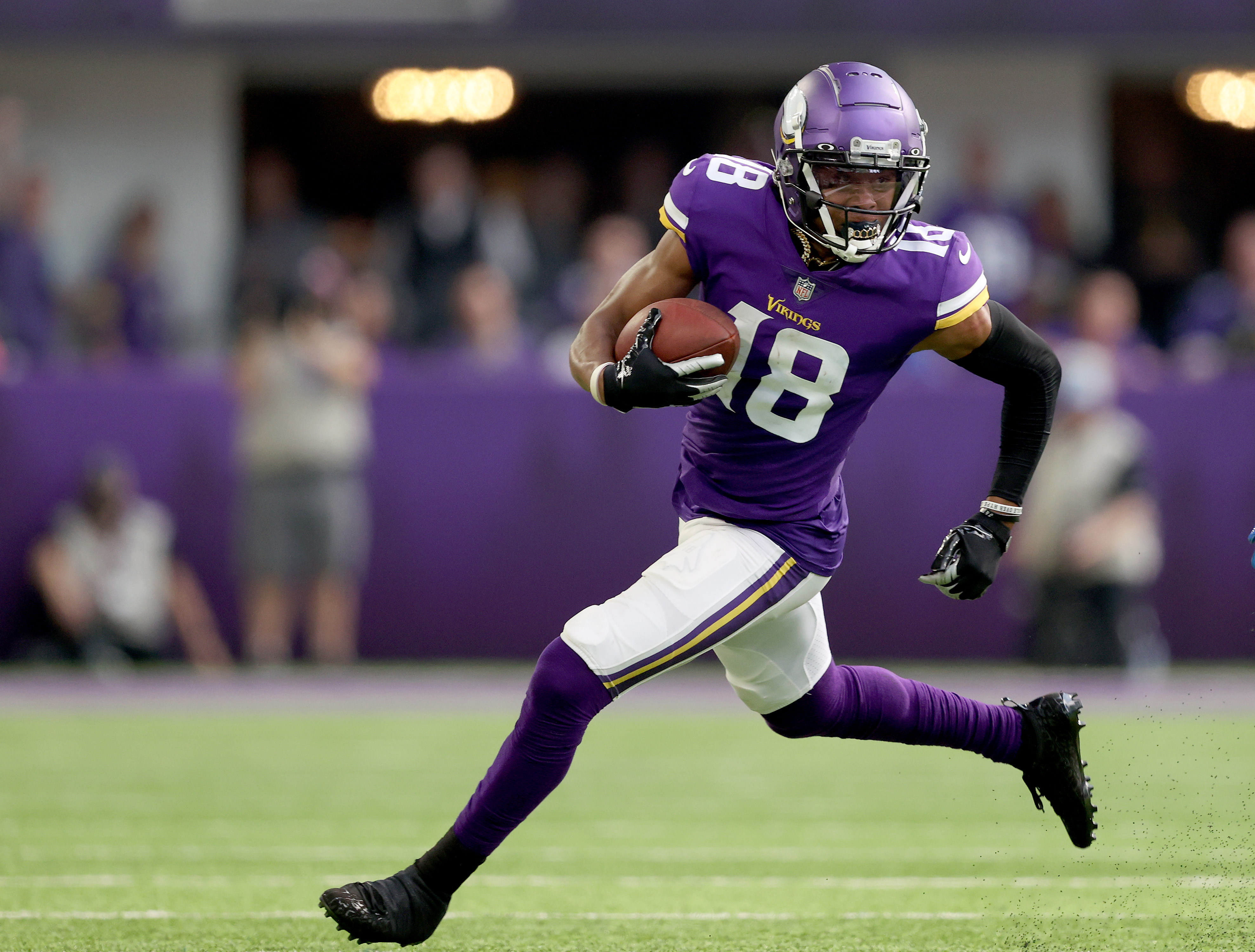Justin Jefferson #18 of the Minnesota Vikings carries the ball in the first half against the Detroit Lions at U.S. Bank Stadium on October 10, 2021 in Minneapolis, Minnesota. The Minnesota Vikings defeated the Detroit Lions 19-17.