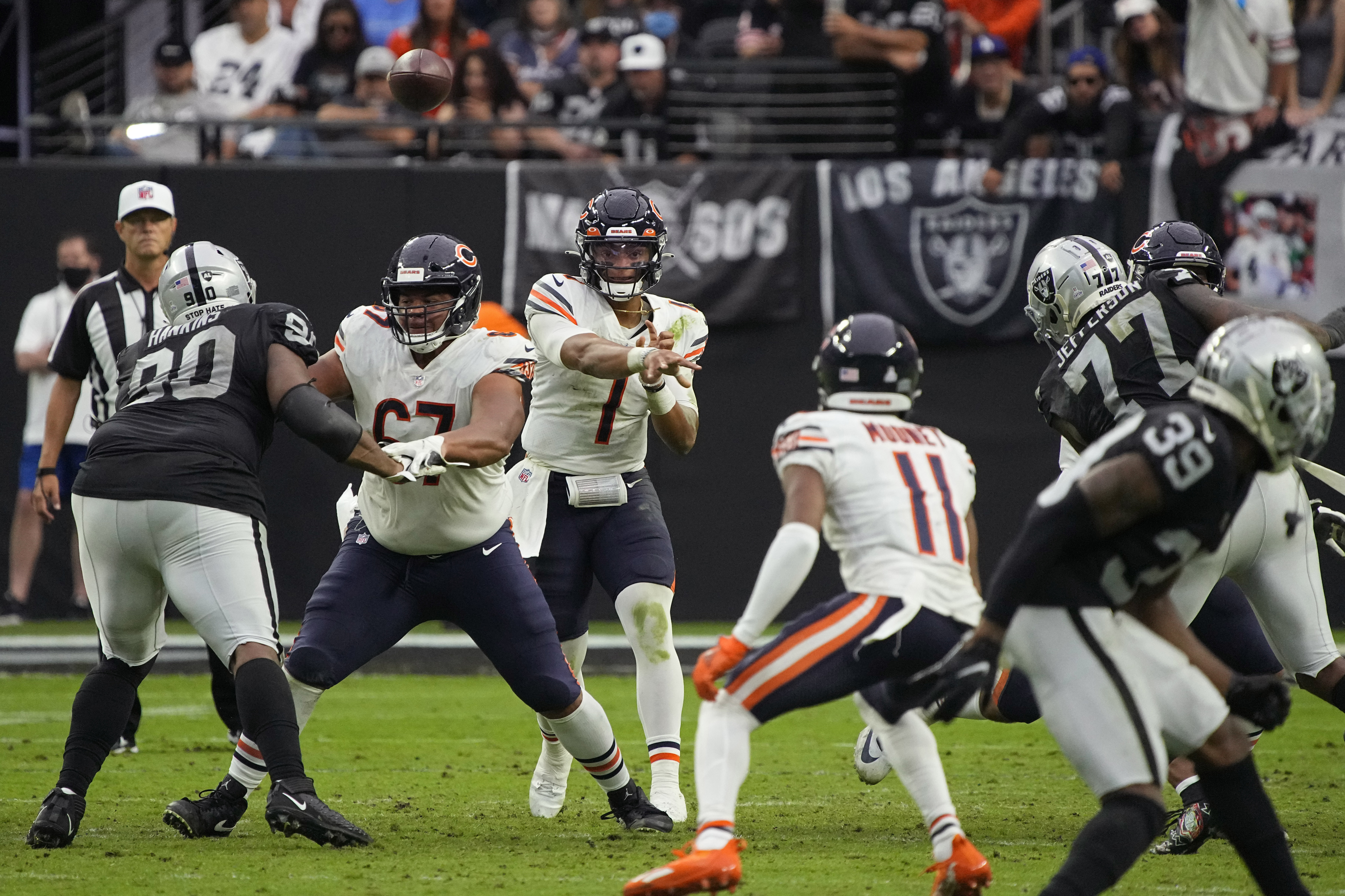 Bears quarterback Justin Fields (1, throwing a completion to Darnell Mooney) threw for 111 yards against the Raiders last week.