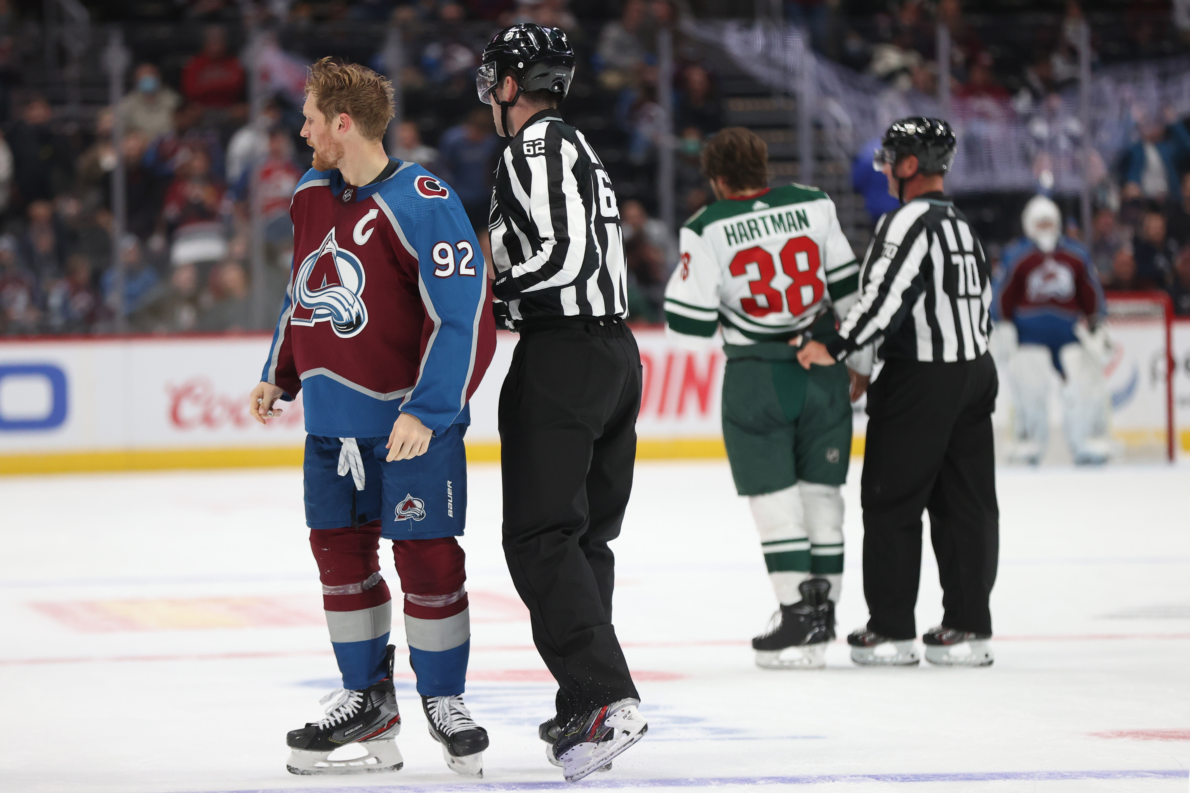 Gabriel Landeskog #92 of the Colorado Avalanche is separated from Ryan Hartman #38 of the Minnesota Wild after fighting in the second period at Ball Arena on September 30, 2021 in Denver, Colorado.