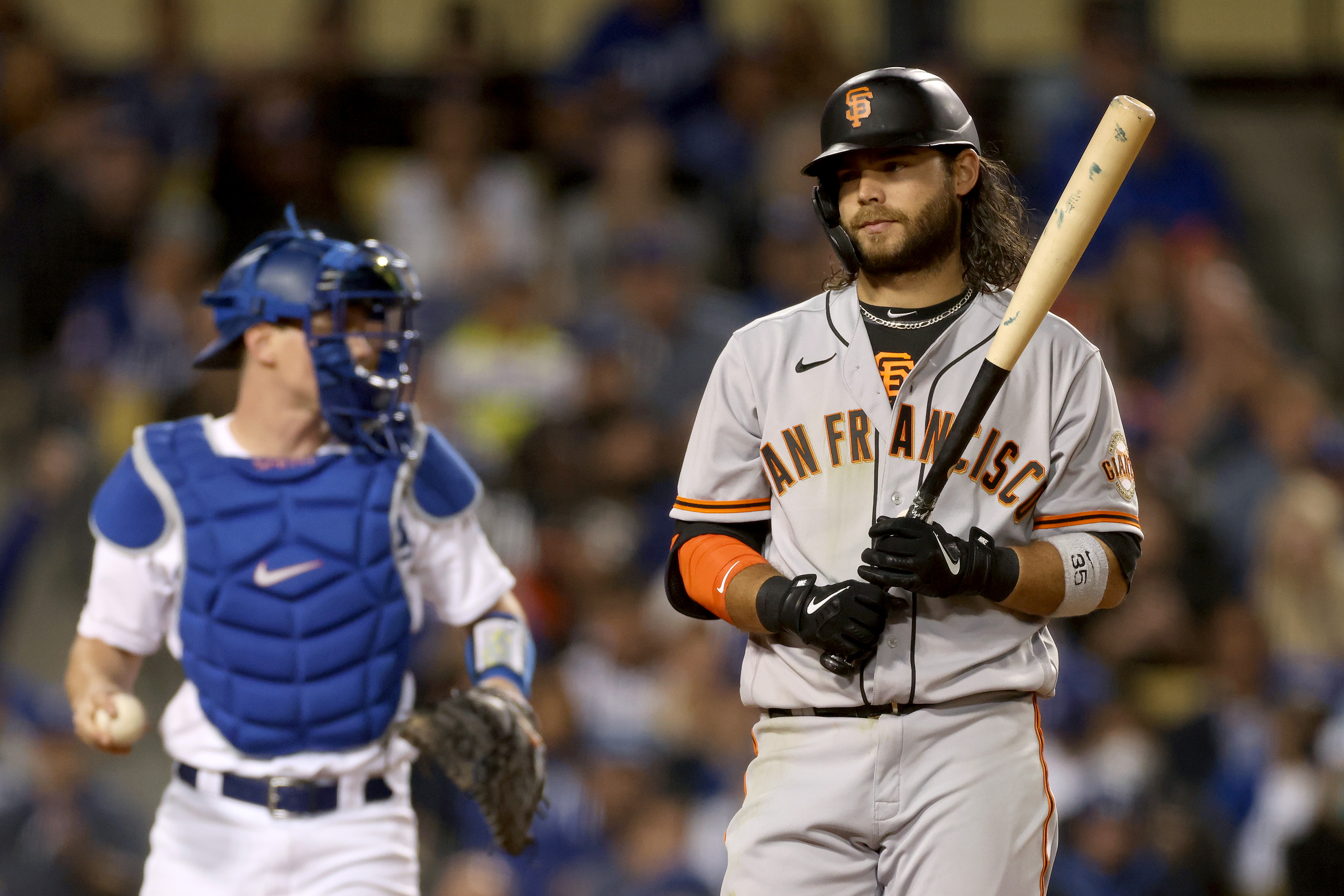 Brandon Crawford #35 of the San Francisco Giants reacts after striking out against the Los Angeles Dodgers during the fourth inning in game 4 of the National League Division Series at Dodger Stadium on October 12, 2021 in Los Angeles, California.