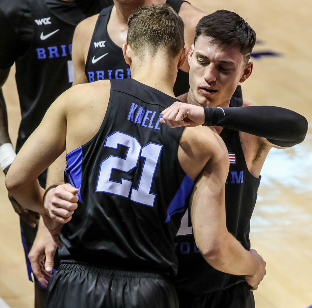 Brigham Young Cougars guard Alex Barcello (13) hugs his teammates and coaches.