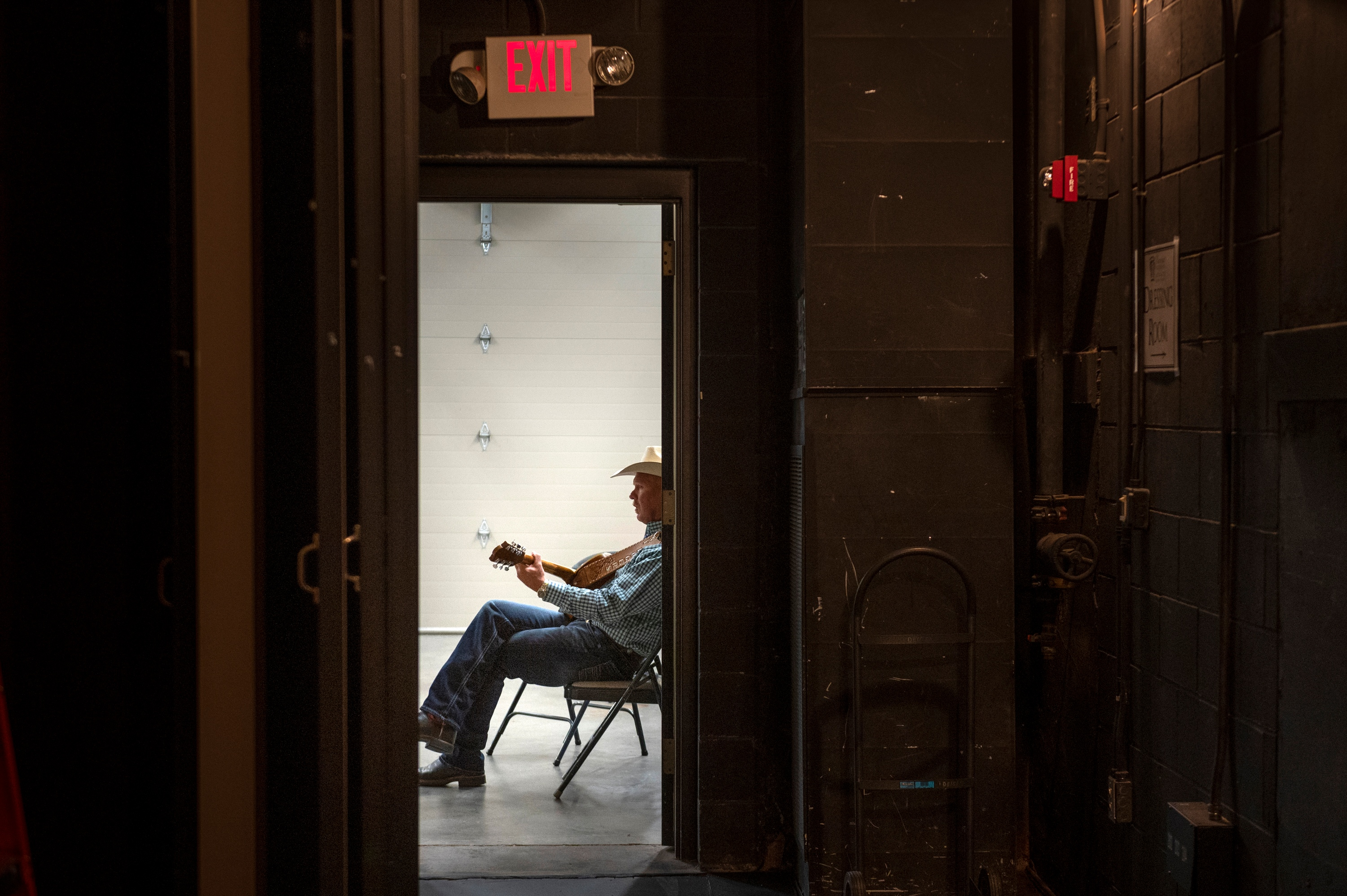 Bar J Wranglers musician Danny Rogers warms up backstage before a show in Kearney, Neb., on Thursday, Oct. 7, 2021.