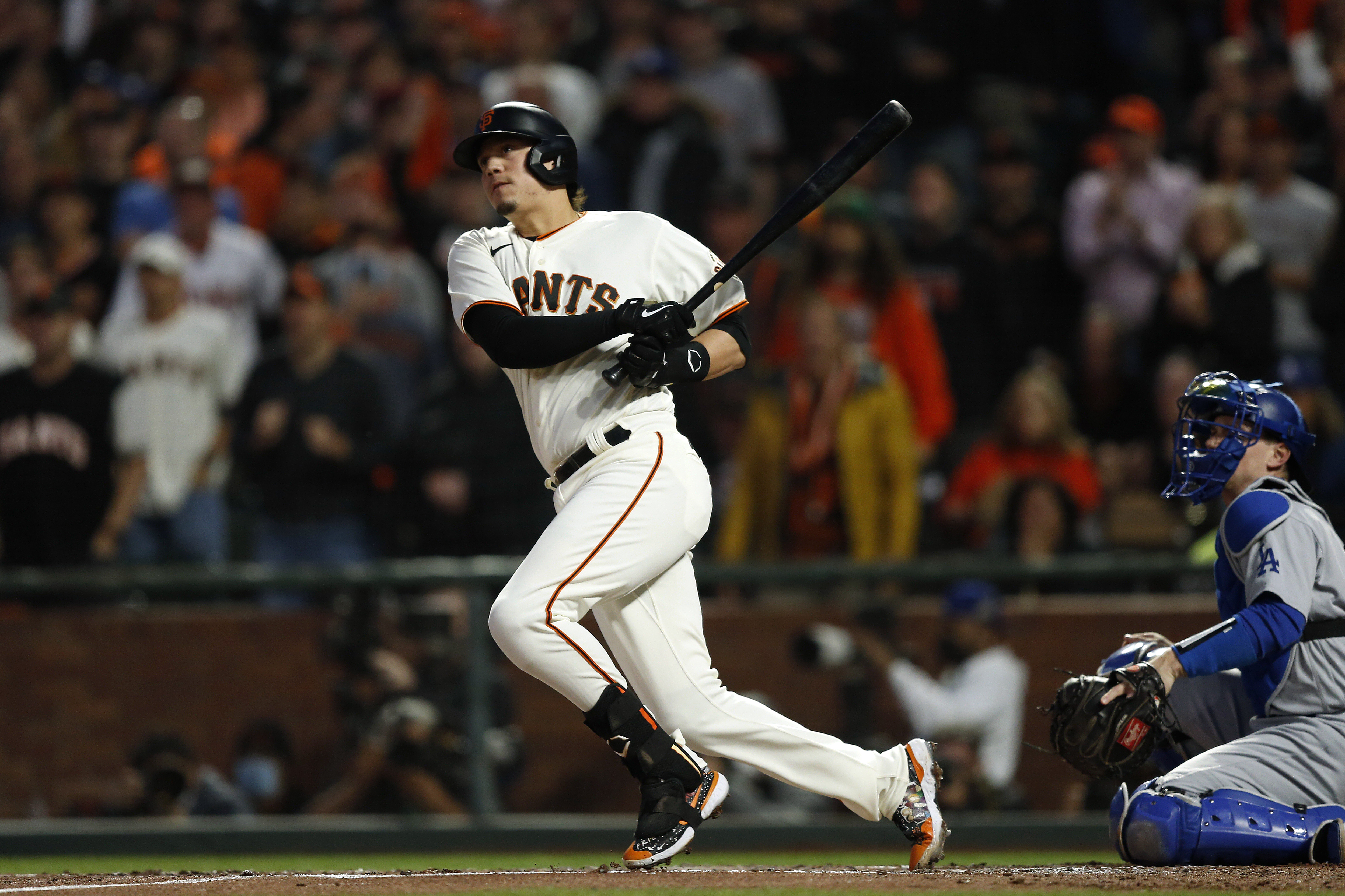 Wilmer Flores #41 of the San Francisco Giants hits a single in the second inning during Game 5 of the NLDS between the Los Angeles Dodgers and the San Francisco Giants at Oracle Park on Thursday, October 14, 2021 in San Francisco, California.
