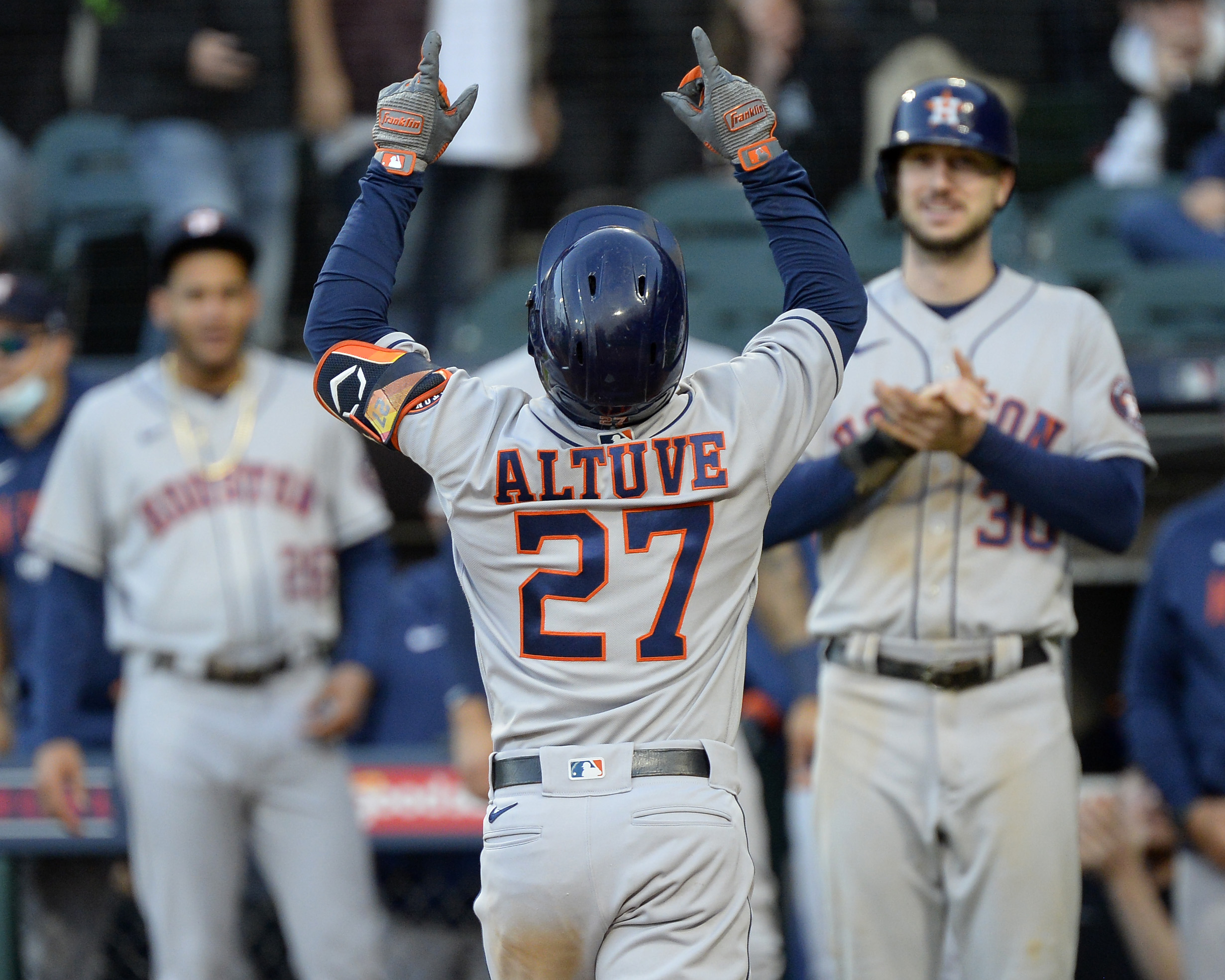 Jose Altuve #27 of the Houston Astros celebrates after hitting a three-run home run in the ninth inning during Game Four of the American League Division Series against the Chicago White Sox on October 12, 2021 at Guaranteed Rate Field in Chicago, Illinois.