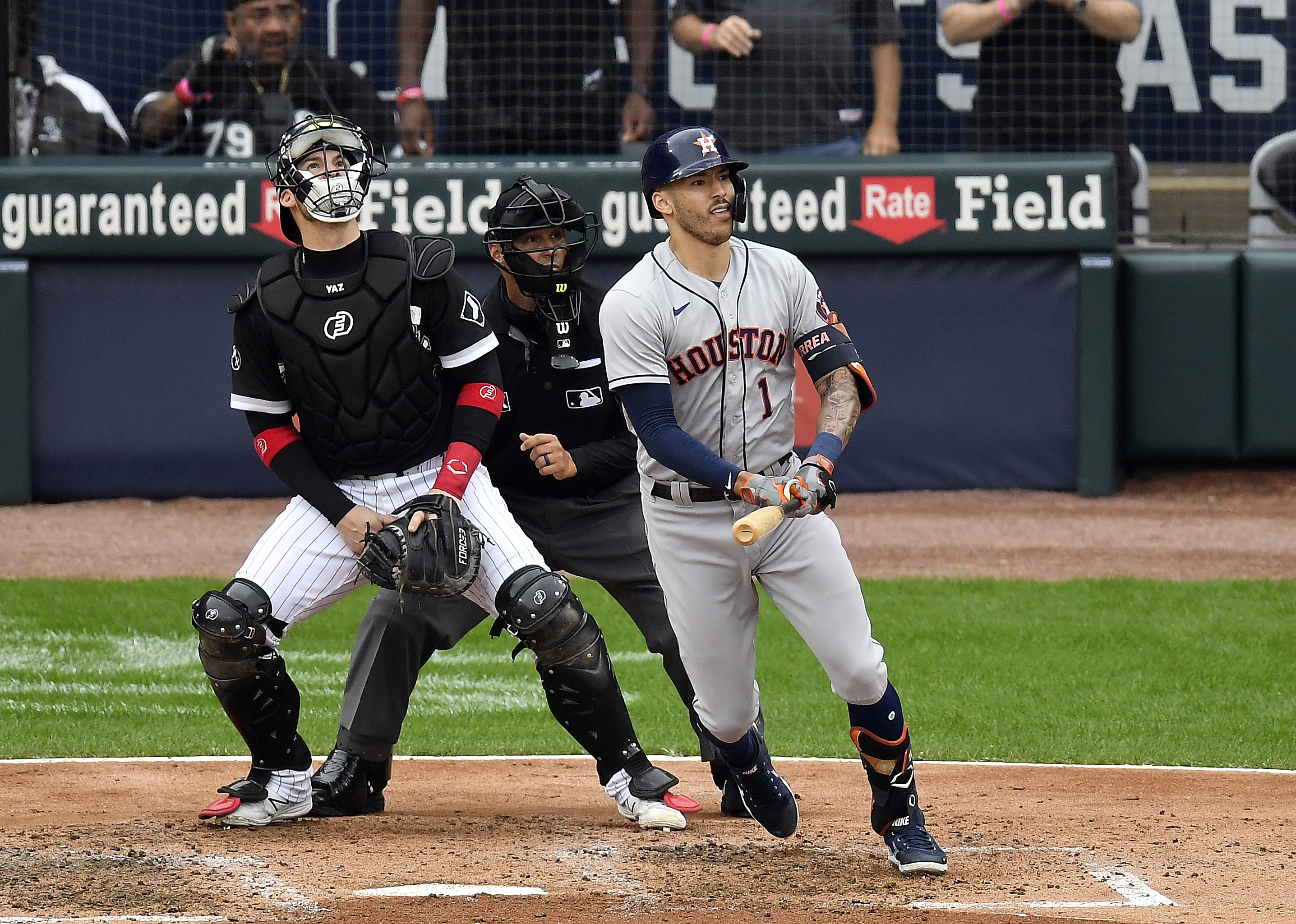 Carlos Correa #1 of the Houston Astros hits a two-run double during the 3rd inning of Game 4 of the American League Division Series against the Chicago White Sox at Guaranteed Rate Field on October 12, 2021 in Chicago, Illinois.