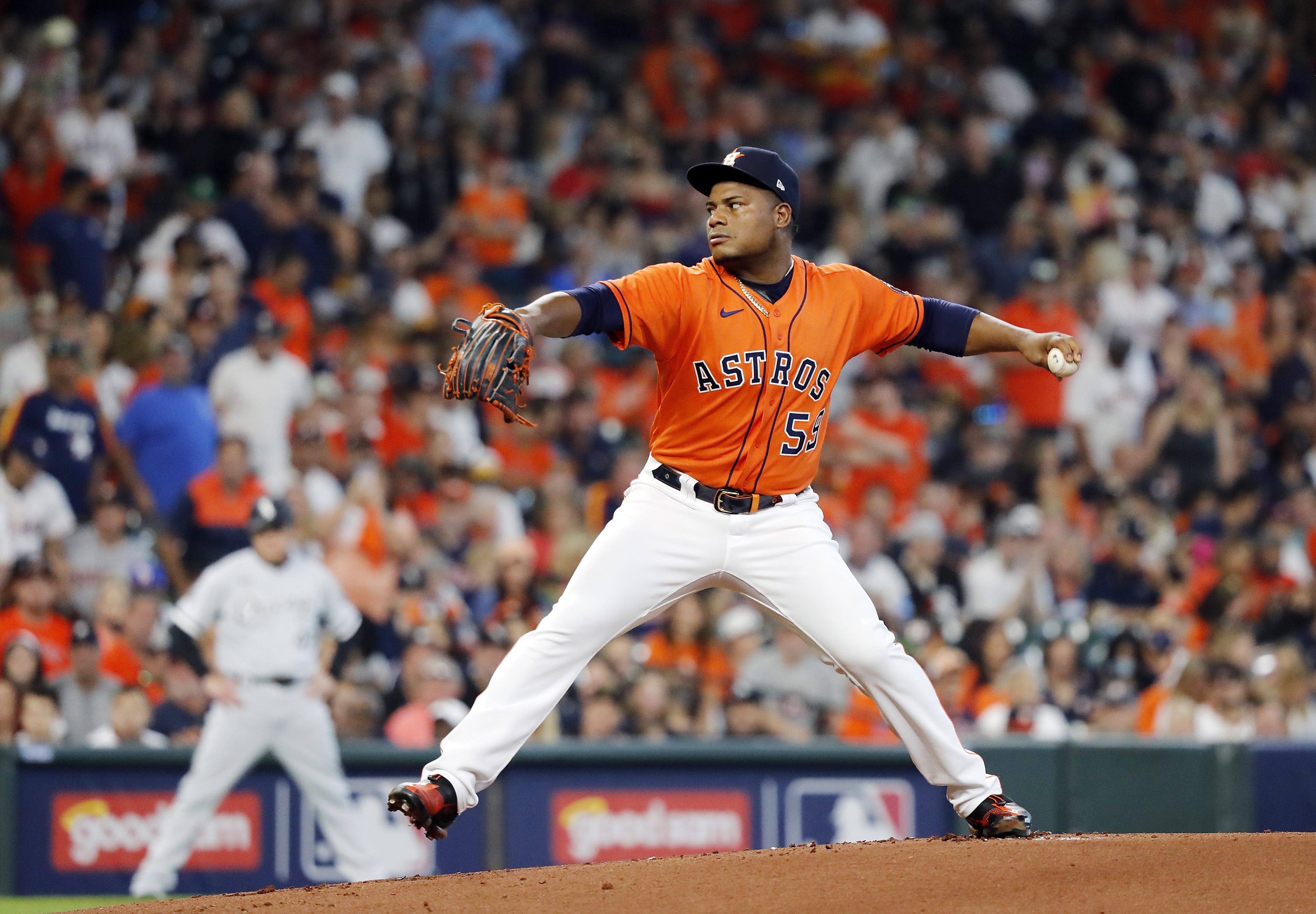 Starting pitcher Framber Valdez #59 of the Houston Astros pitches during the 1st inning of Game 2 of the American League Division Series against the Chicago White Sox at Minute Maid Park on October 08, 2021 in Houston, Texas.