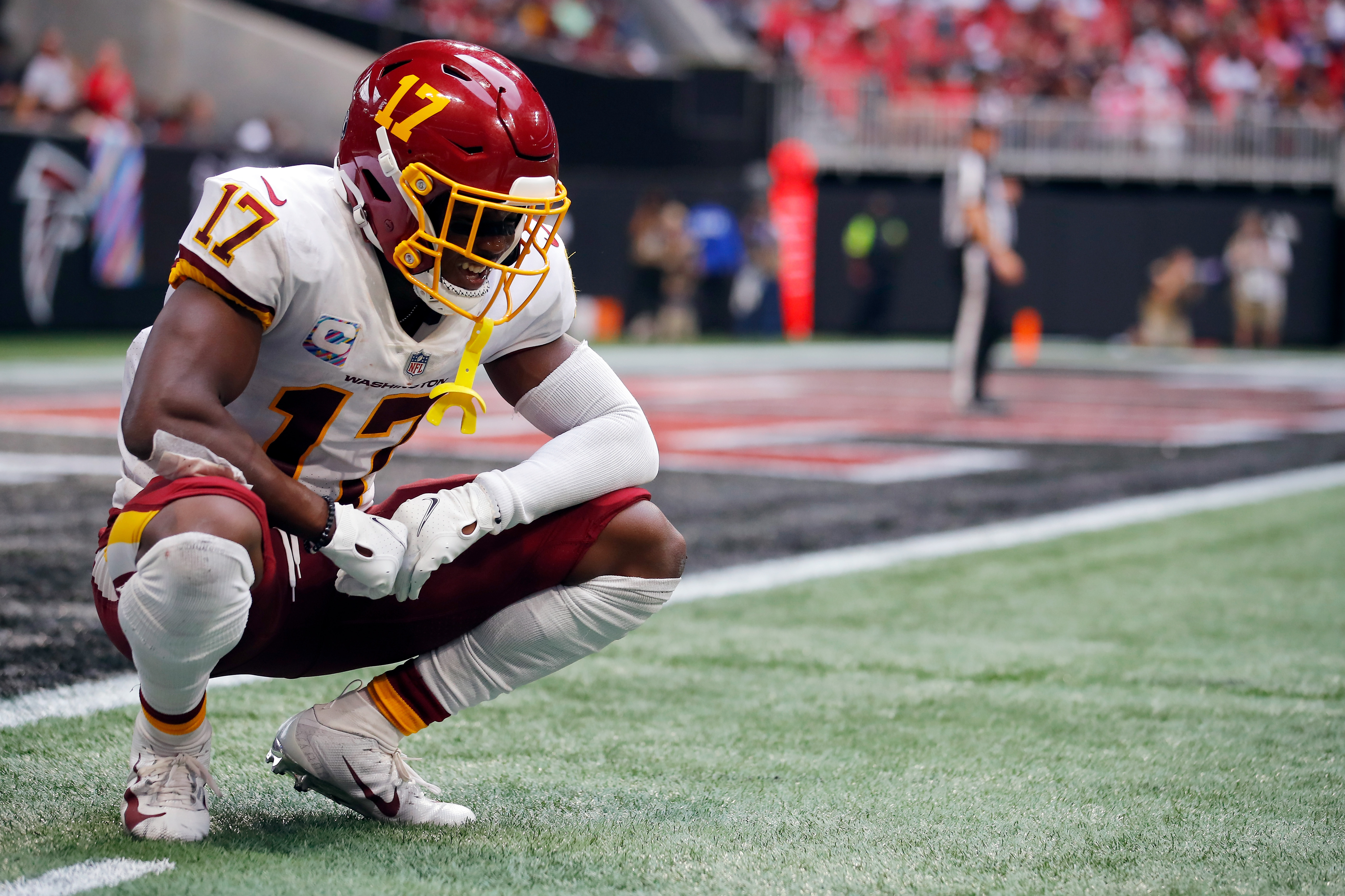 Terry McLaurin #17 of the Washington Football Team takes a moment to collect himself after being hit on the previous play against the Atlanta Falcons in the fourth quarter at Mercedes-Benz Stadium on October 03, 2021 in Atlanta, Georgia.