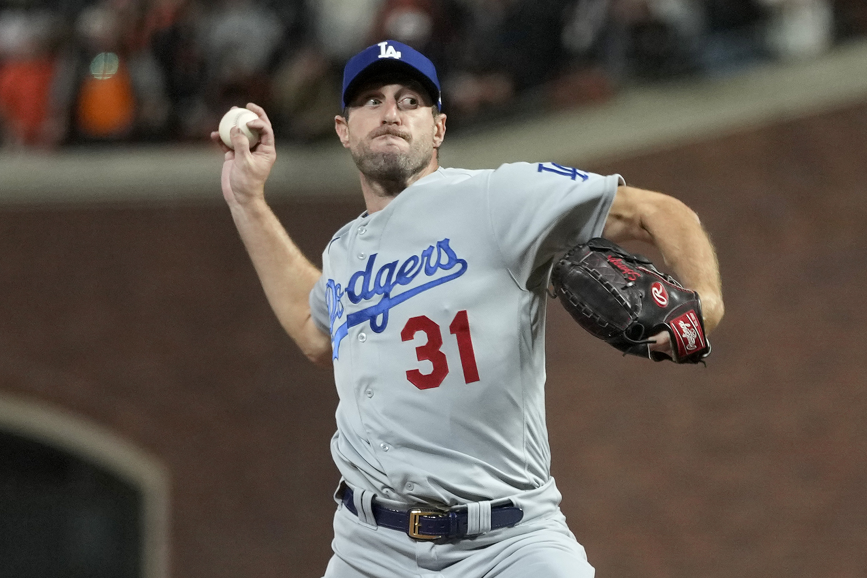 Max Scherzer #31 of the Los Angeles Dodgers pitches against the San Francisco Giants during the ninth inning in game 5 of the National League Division Series at Oracle Park on October 14, 2021 in San Francisco, California.