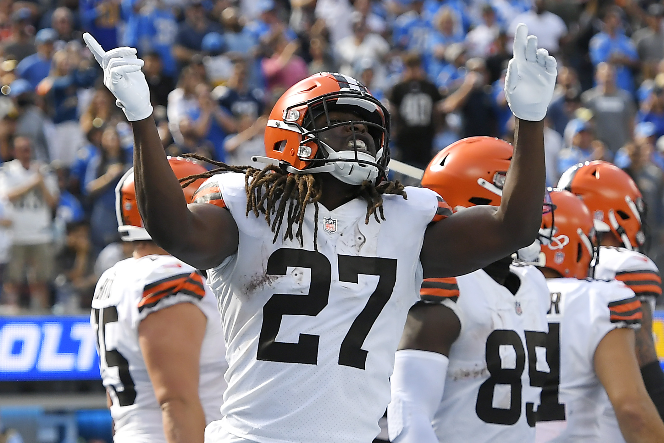 Kareem Hunt #27 of the Cleveland Browns celebrates after running for a touchdown during the second quarter against the Los Angeles Chargers at SoFi Stadium on October 10, 2021 in Inglewood, California.