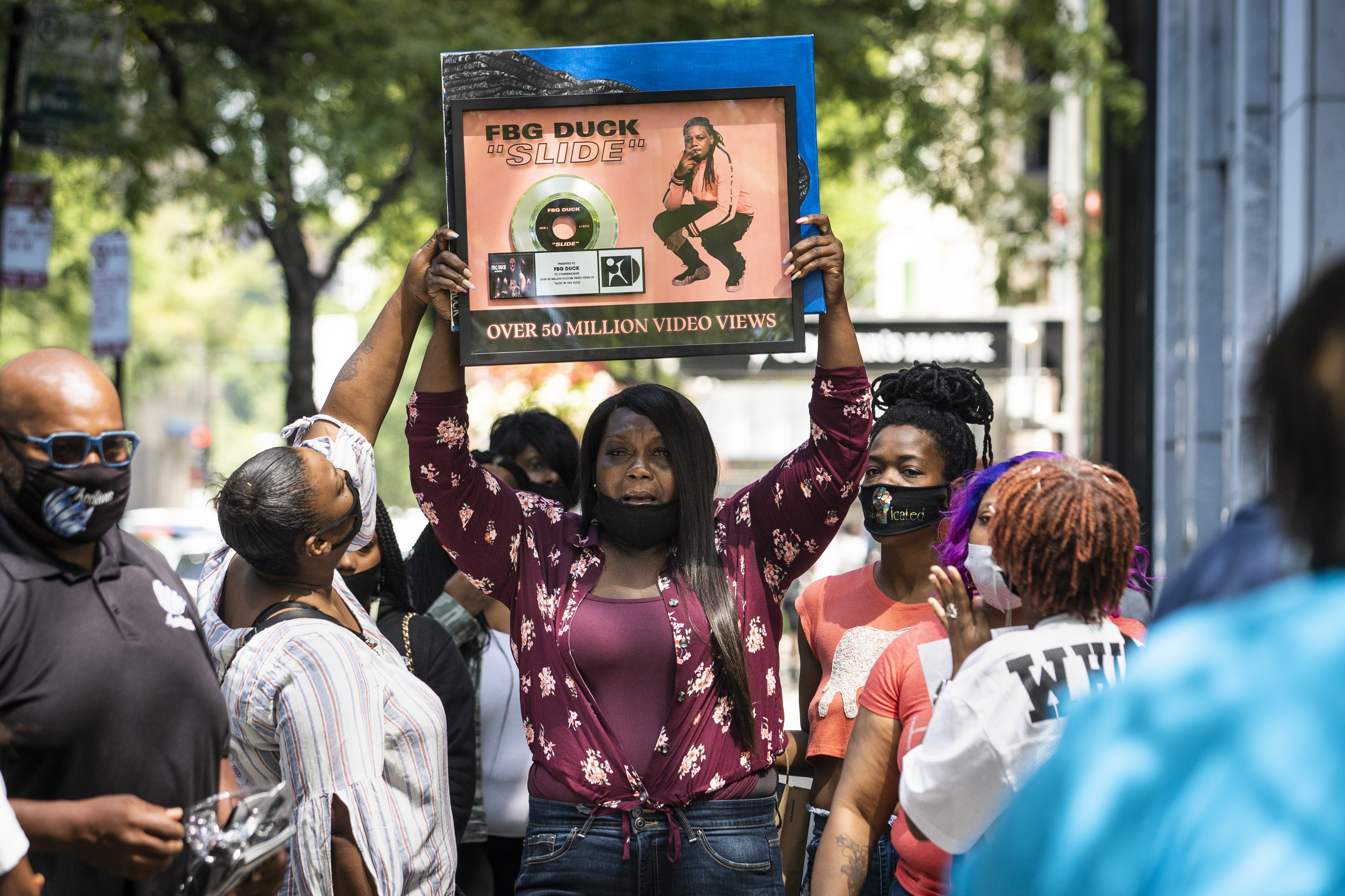 LaSheenaWeekly, mother of Carlton Weekly, who performed as FBG Duck, held a news conference with family and friends near the scene of her son's fatal shooting in the first block of East Oak Street in the Gold Coast, Friday, Aug. 7, 2020.