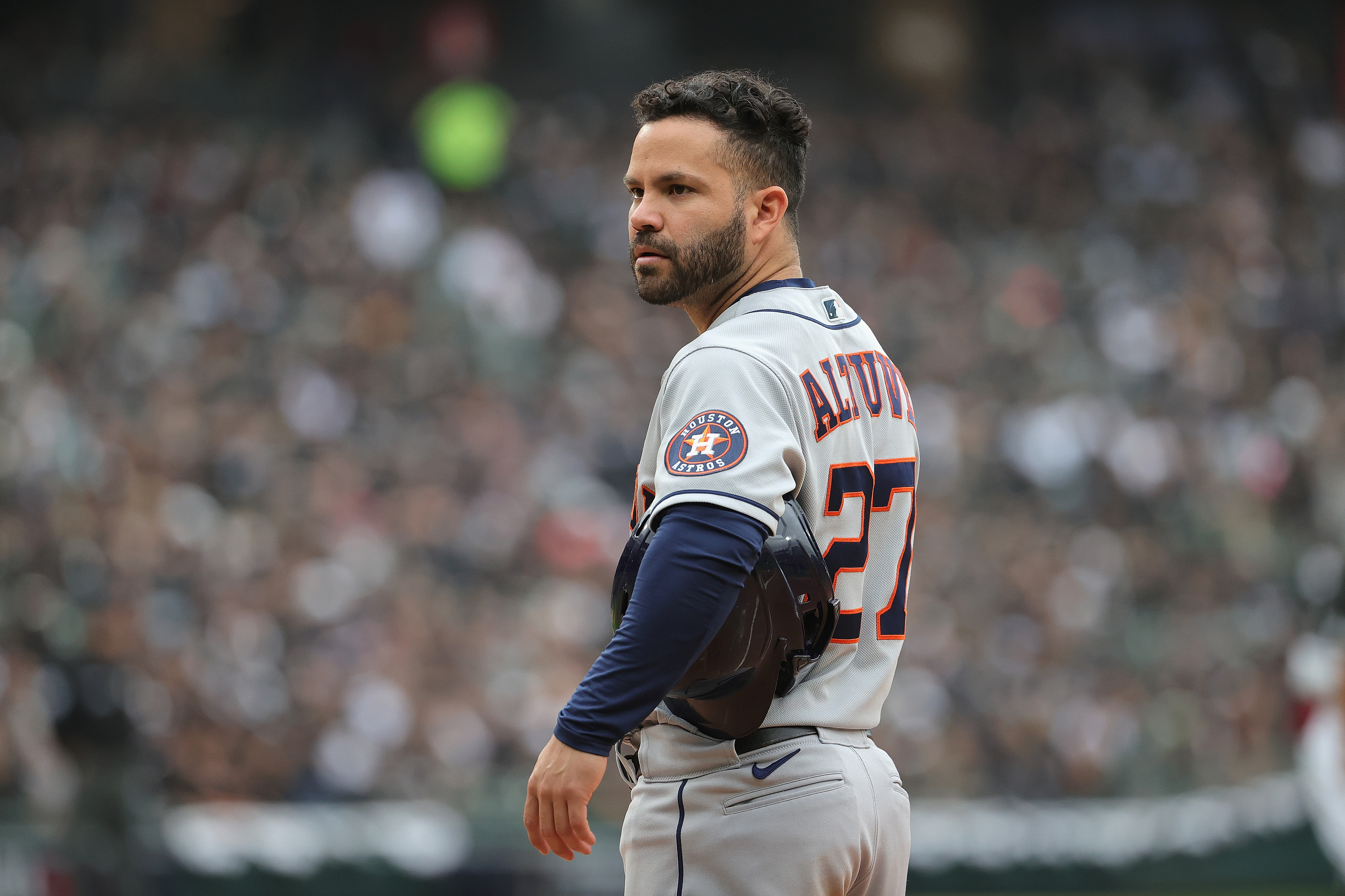 Jose Altuve #27 of the Houston Astros waits at first base during a pitching change by the Chicago White Sox at Guaranteed Rate Field on October 12, 2021 in Chicago, Illinois. The Astros defeated the White Sox 10-1.