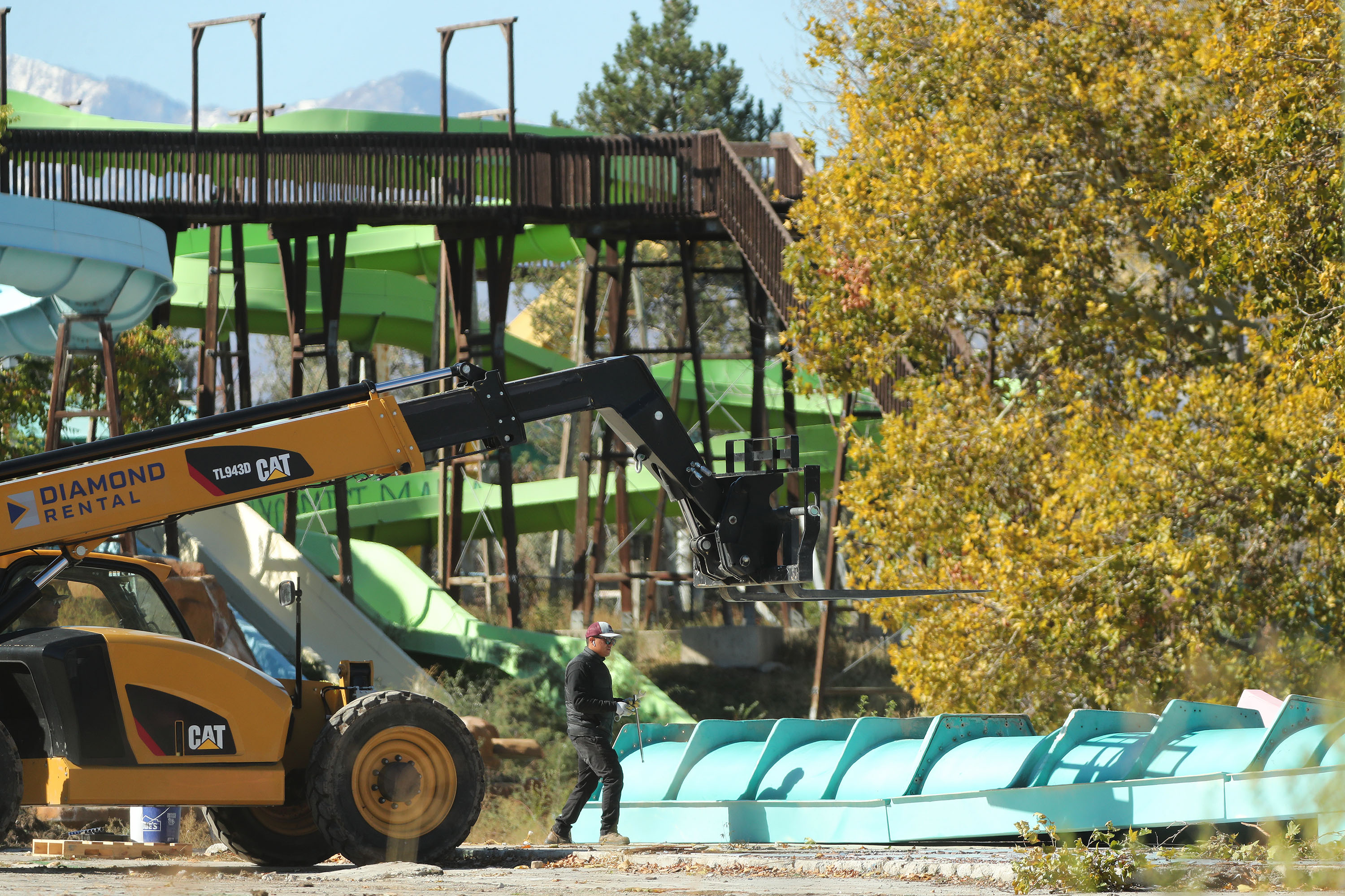 Workers tear down the old Raging Waters/Seven Peaks water park in Salt Lake City on Friday, Oct. 15, 2021.