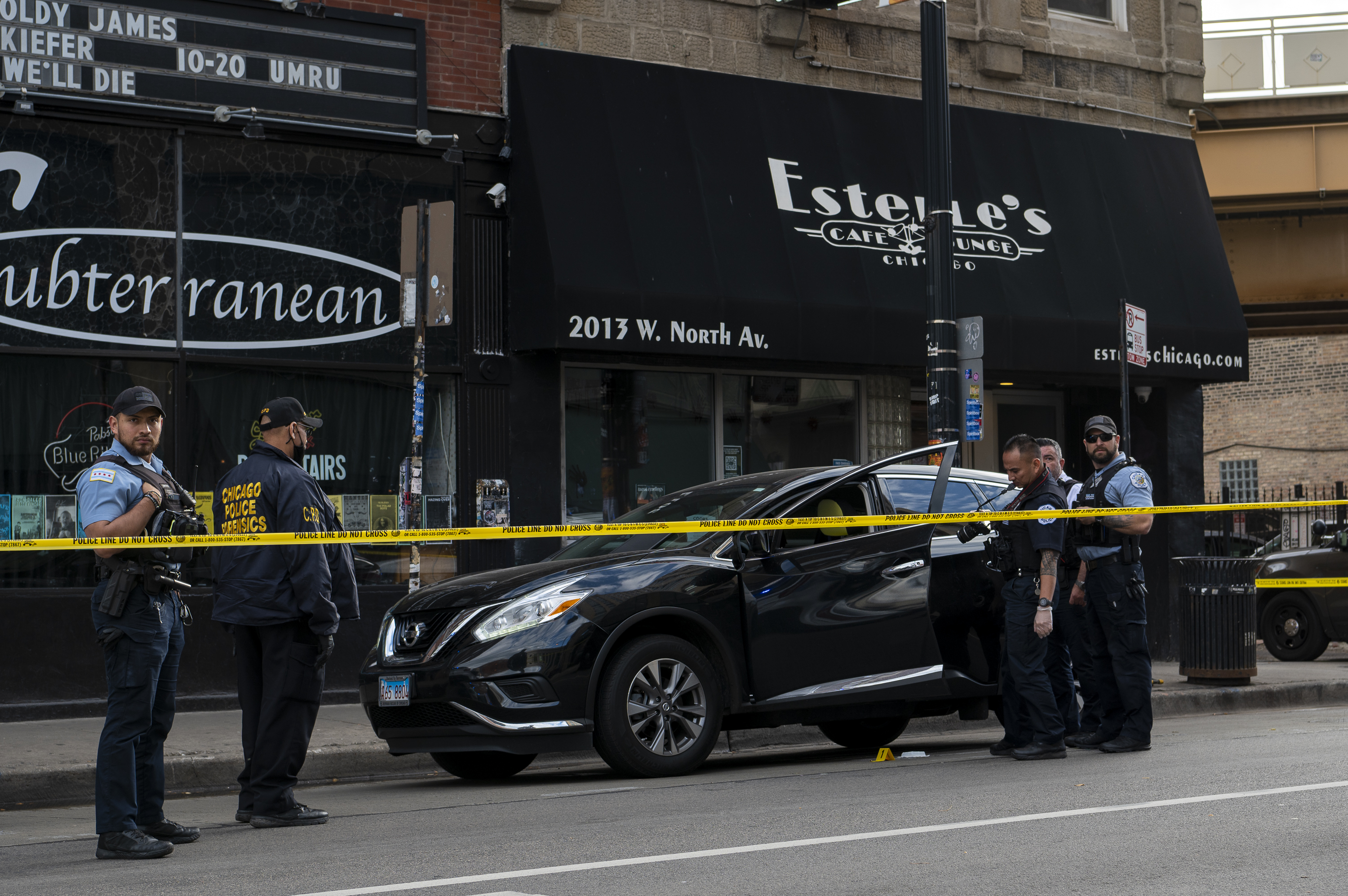 Chicago police work the scene where a 55-year-old man was shot in 2000 block of West North Avenue in the Wicker Park neighborhood, Friday, Oct. 15, 2021.