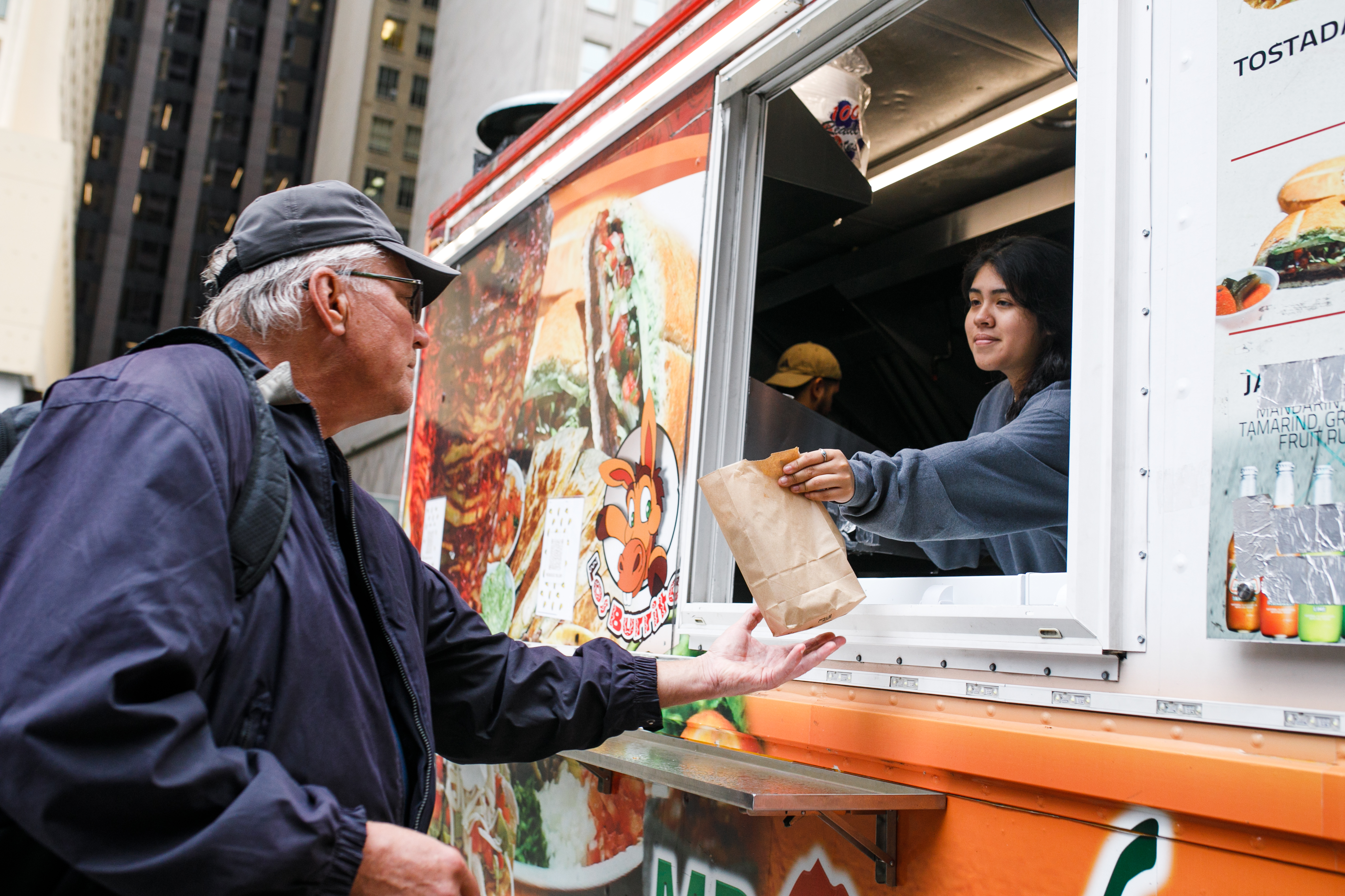 Mr. Quiles food truck serves up fresh tacos, quesadillas and burritos at the Daley Plaza's Chicago Food Truck Fest. Gabi Hernandez serves a customer at the Mr. Quiles food truck at Daley Plaza, Friday afternoon, Oct. 15, 2021. Mark Capapas/Sun-Times