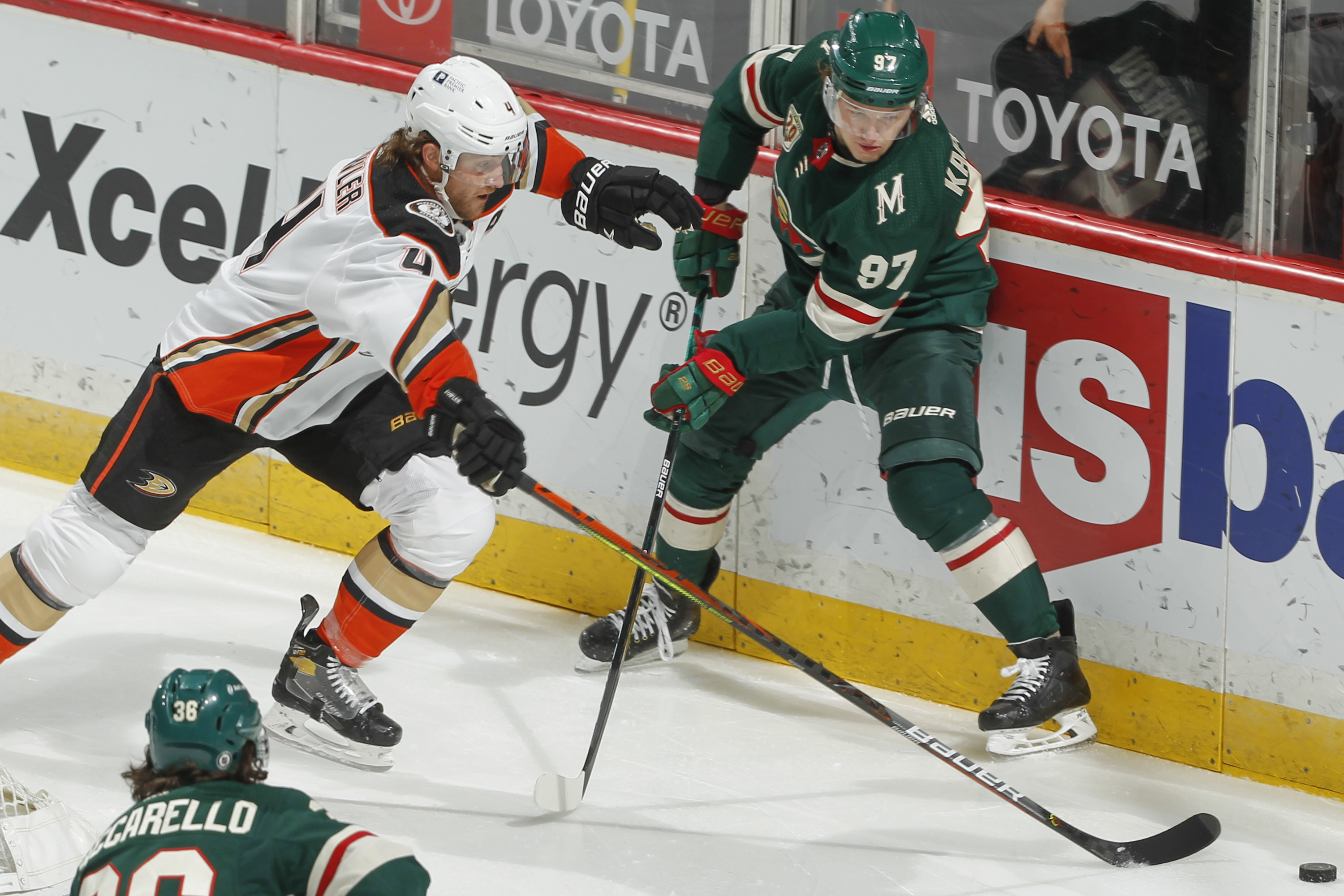 Cam Fowler #4 of the Anaheim Ducks and Kirill Kaprizov #97 of the Minnesota Wild battle for the puck during the game at the Xcel Energy Center on May 8, 2021 in Saint Paul, Minnesota.