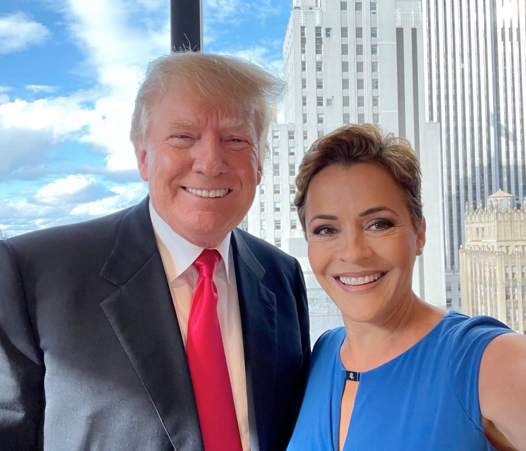 President Donald Trump, left, and Kari Lake, a Republican gubernatorial candidate in Arizona, pose for a selfie.