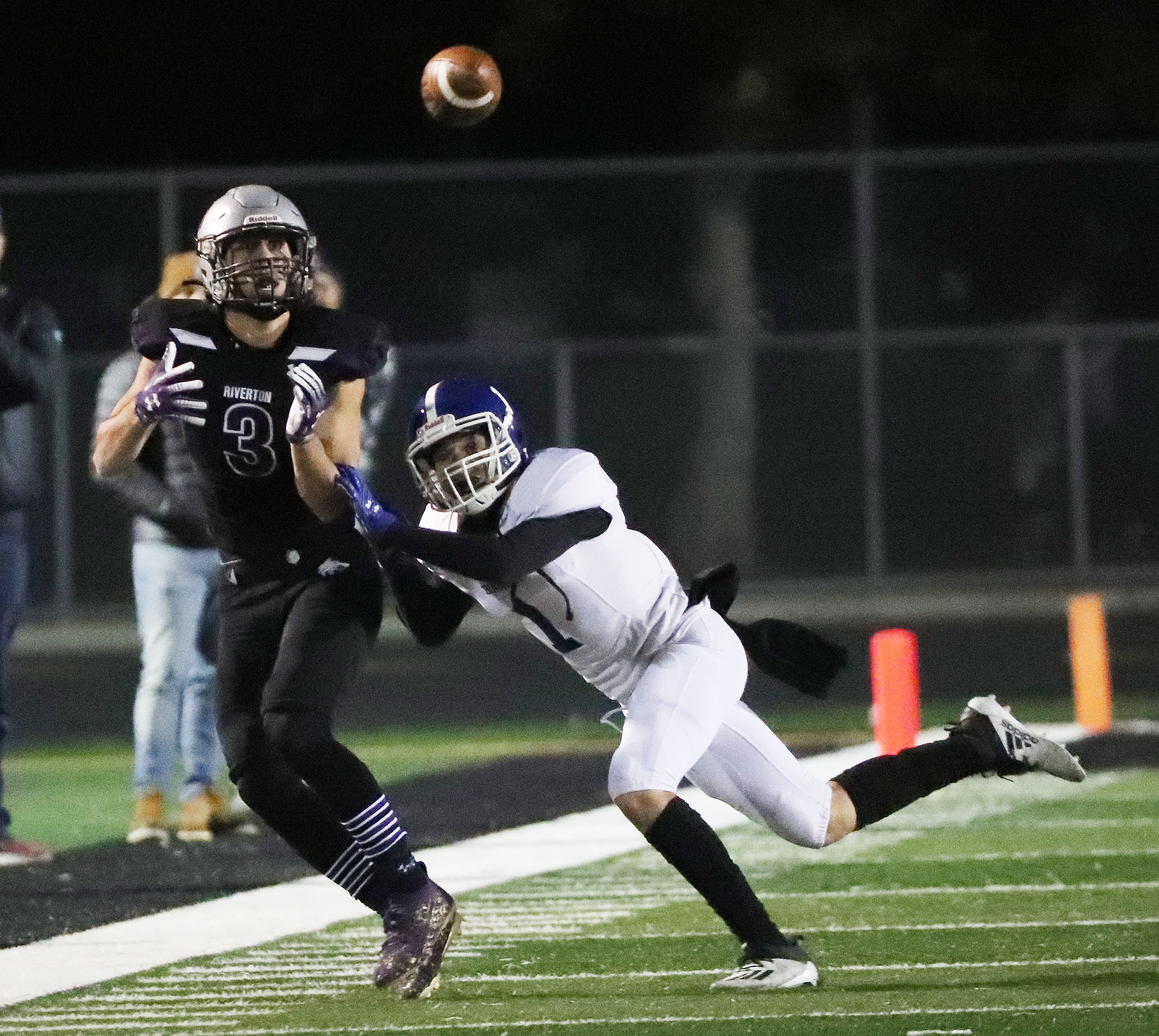 Riverton and Bingham compete in a high school football game in Riverton on Thursday, Oct. 14, 2021.